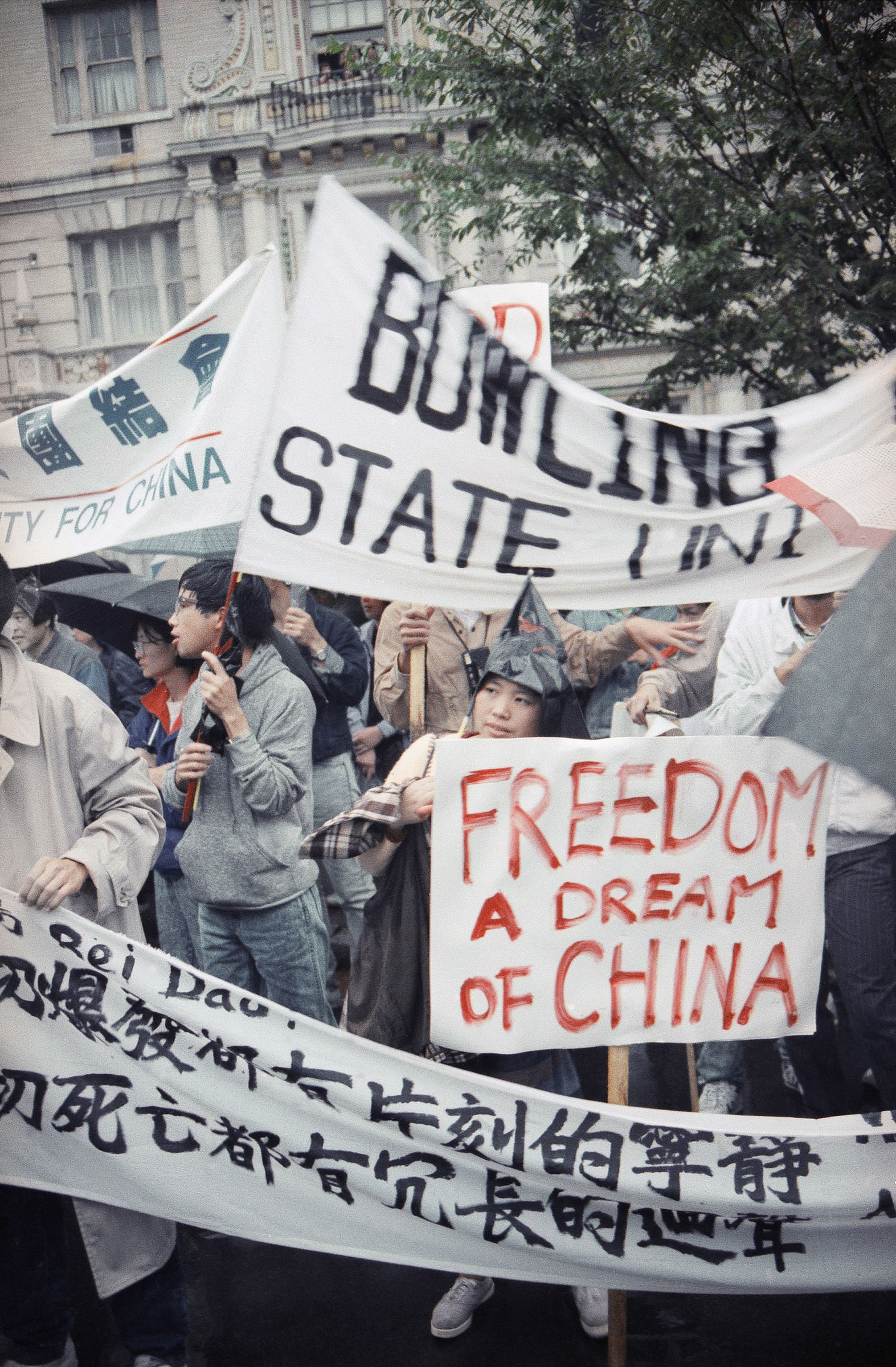 Students gather and protest at the newly named Tiananmen Park, across the street form the Chinese Embassy in Washington on Sunday, Oct. 1, 1989.