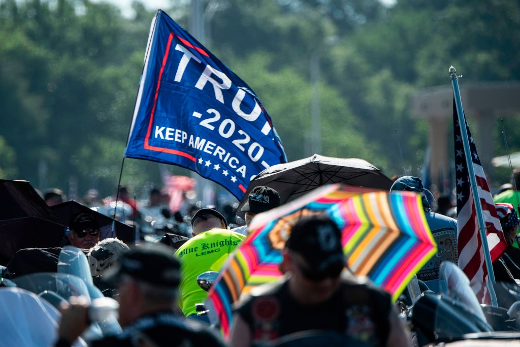 A  Trump 2020  flag is seen as hundreds of thousands of bikers gather on the Pentagon Parking before taking part in the  Rolling thunder  parade, part of the Memorial weekend honouring war veterans in Arlington, near Washington, on May 26 2019. - Thousands of bikers converged on the US capital for what is billed as their last national  Rolling Thunder  ride in honor of missing American soldiers on Memorial Day weekend. They got a boost from President Donald Trump himself, who tweeted Saturday that he would like to help maintain the event, which is bogged down in a dispute over costs.