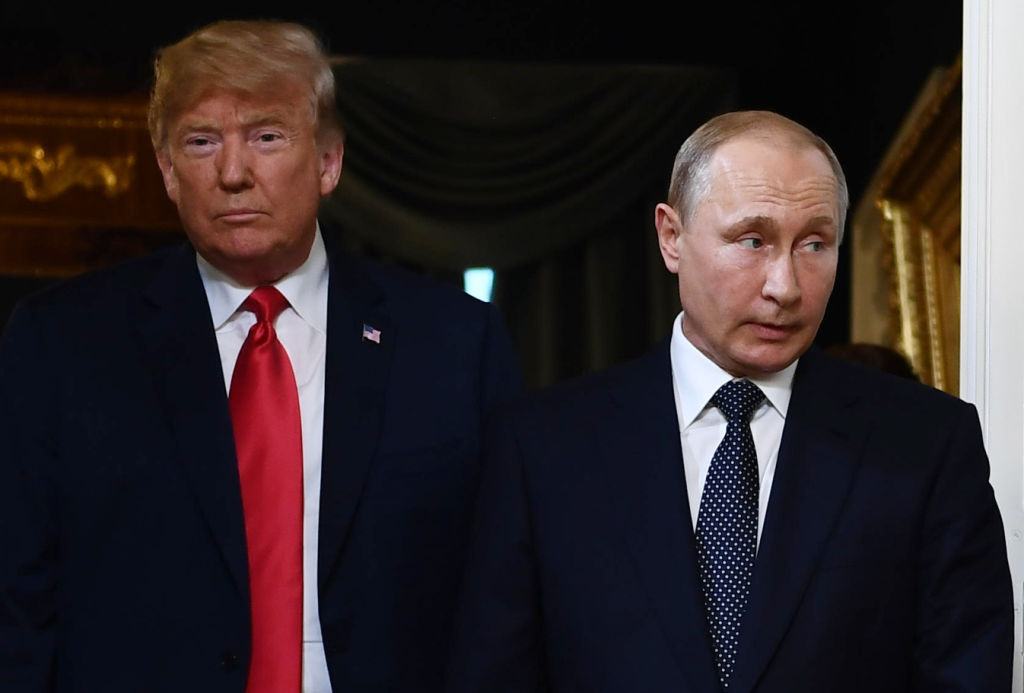 US President Donald Trump and Russian President Vladimir Putin arrive for a meeting in Helsinki, on July 16, 2018. Trump announced on Twitter that he and Putin had a  Very productive talk!  about things including the Mueller report.