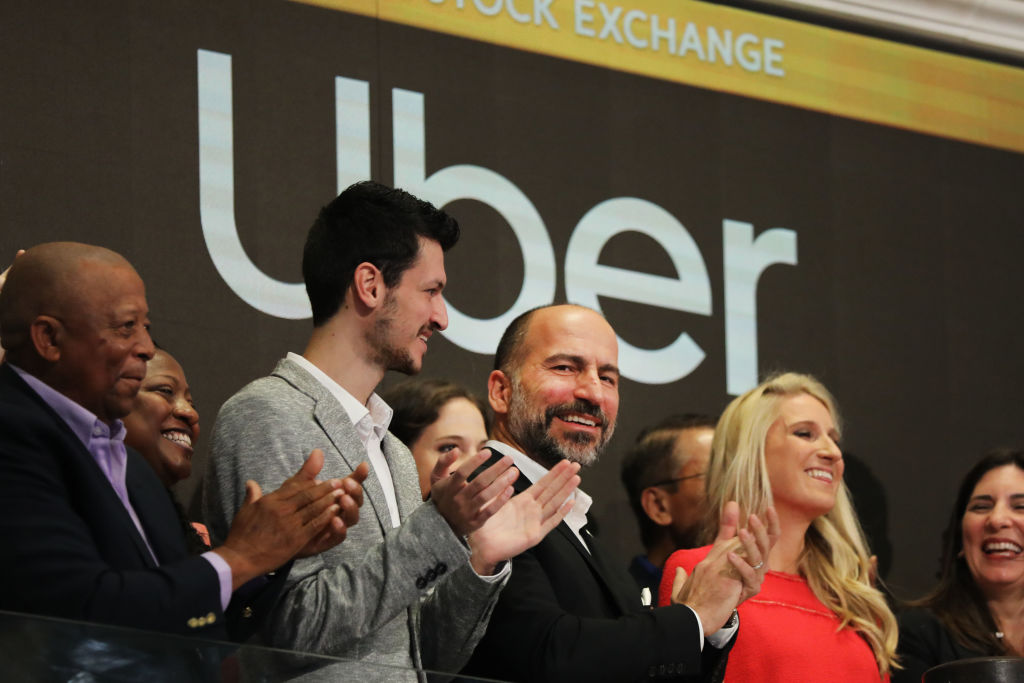 Uber CEO Dara Khosrowshahi (center) joins other employees in ringing the Opening Bell at the New York Stock Exchange (NYSE) as the ride-hailing company Uber makes its highly anticipated initial public offering (IPO) on May 10, 2019 in New York City.