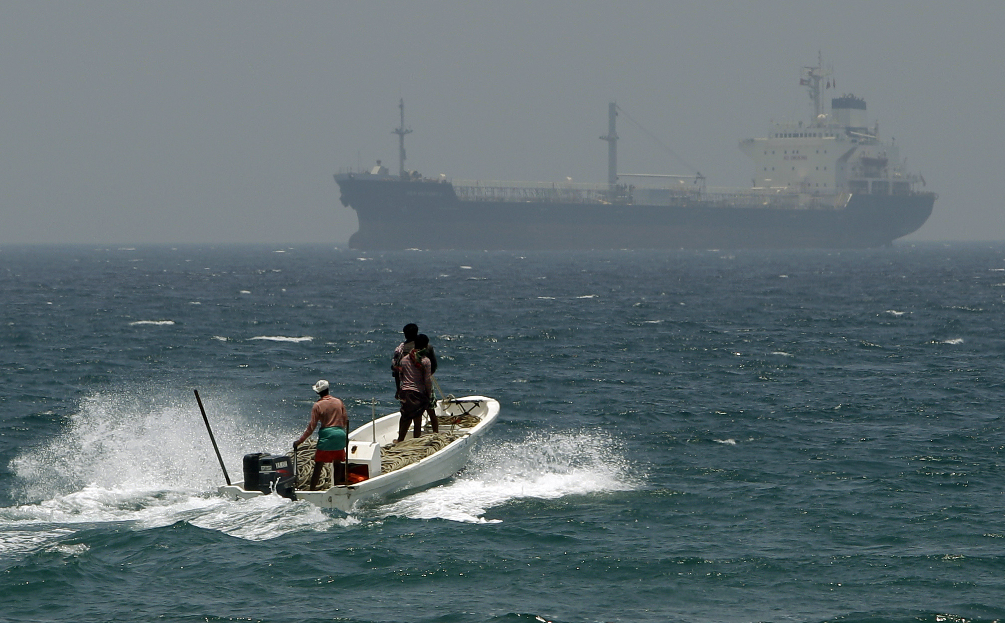 FILE - In this May 30, 2012, file photo, fishermen cross the sea waters off Fujairah, United Arab Emirates, near the Strait of Hormuz. The United Arab Emirates said Sunday, May 12, 2019 that four commercial ships near Fujairah  were subjected to sabotage operations  after false reports circulated in Lebanese and Iranian media outlets saying there had been explosions at the Fujairah port. (AP Photo/Kamran Jebreili, File)