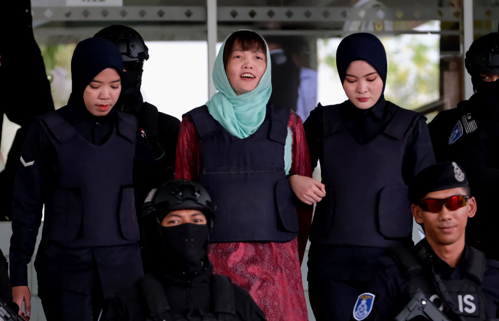 Vietnamese Doan Thi Huong is escorted by police at the Shah Alam High Court in Malaysia on April 1, 2019.