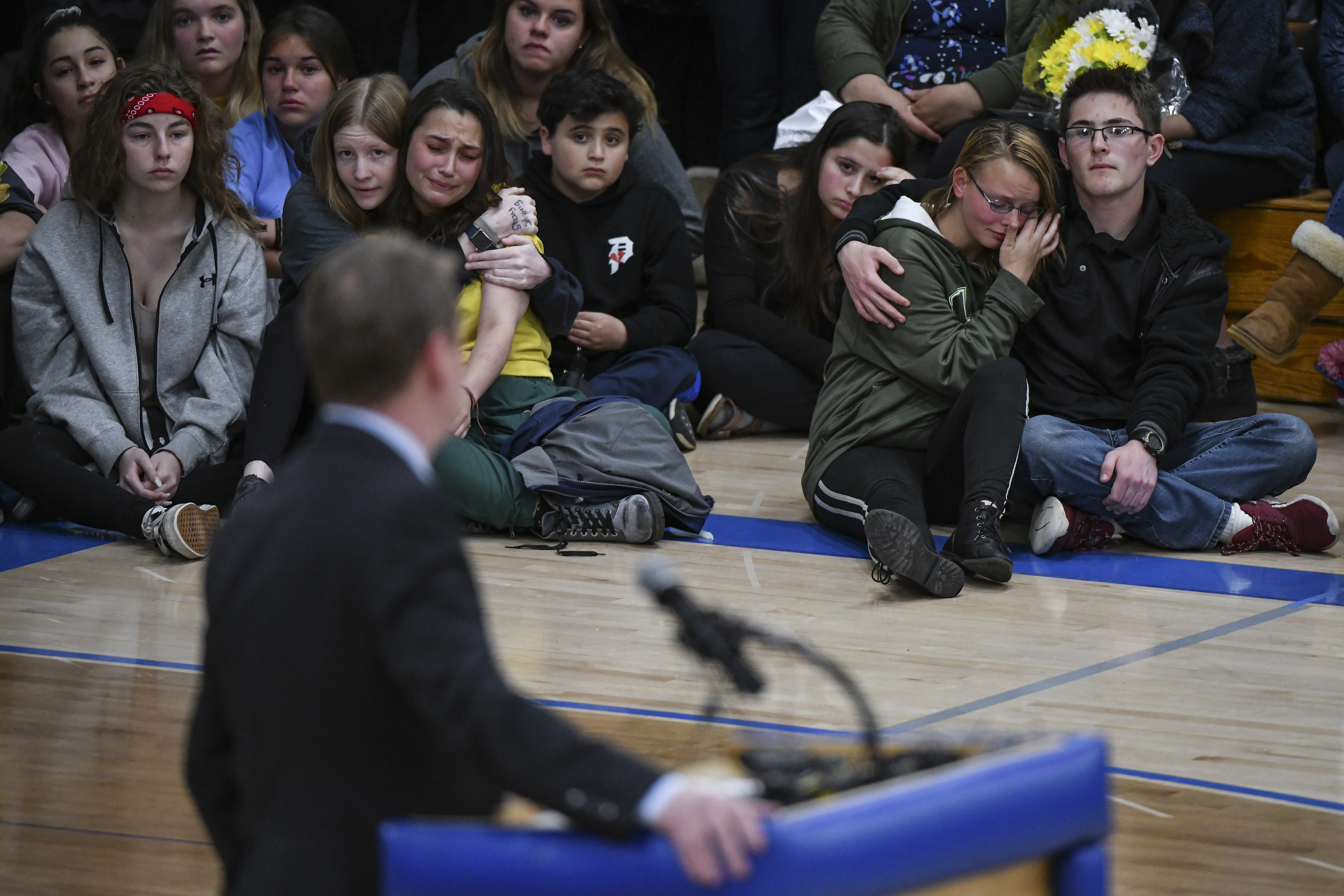 Students listen as Sen. Michael Bennet (D-CO) speaks during a candlelight vigil at Highlands Ranch High School on May 8, 2019 in Highlands Ranch, Colorado. One student was killed and eight others were injured during a shooting at STEM School Highlands Ranch on Tuesday.