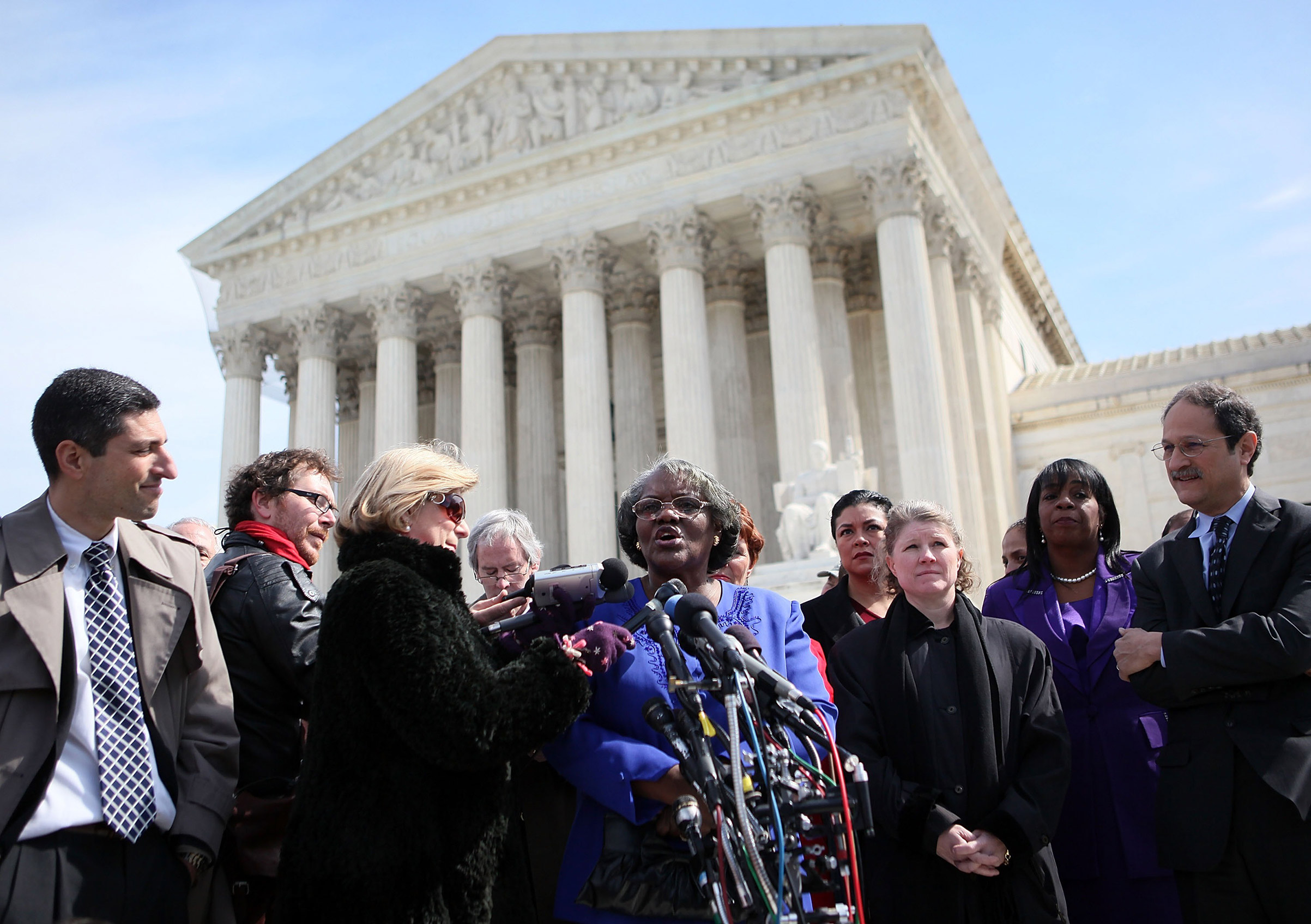 Betty Dukes, the lead plaintiff in the original class action, speaks in front of the Supreme Court in 2011