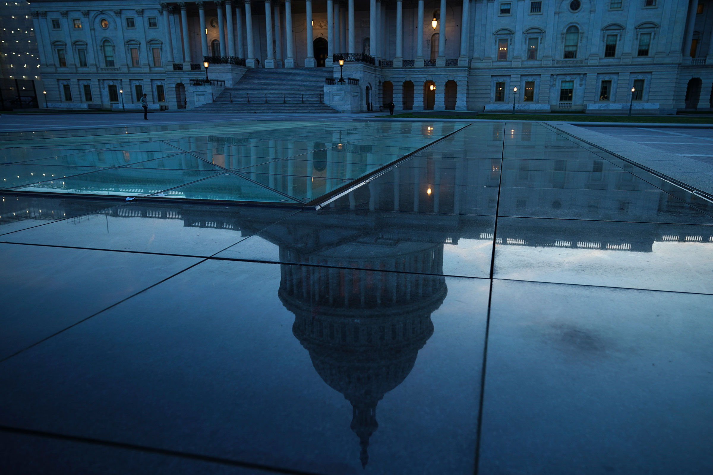 The U.S. Capitol dome is reflected on the plaza of the East Front of the U.S. Capitol, in Washington, DC on April 17, 2019.