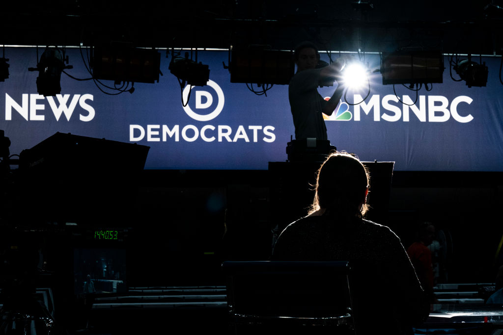 Workers assemble the television set for the first Democratic presidential primary debates for the 2020 elections, which will take place in Miami, Florida on June 26, 2019