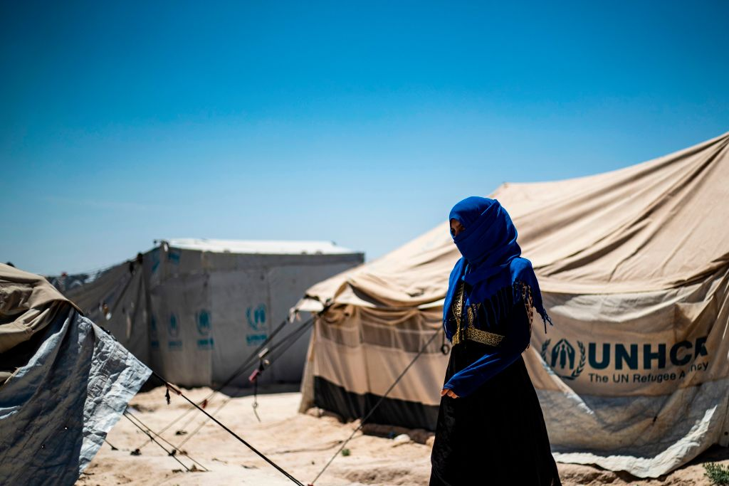 A woman walks inside al-Hol camp for displaced people in northeastern Syria on May 28, 2019.