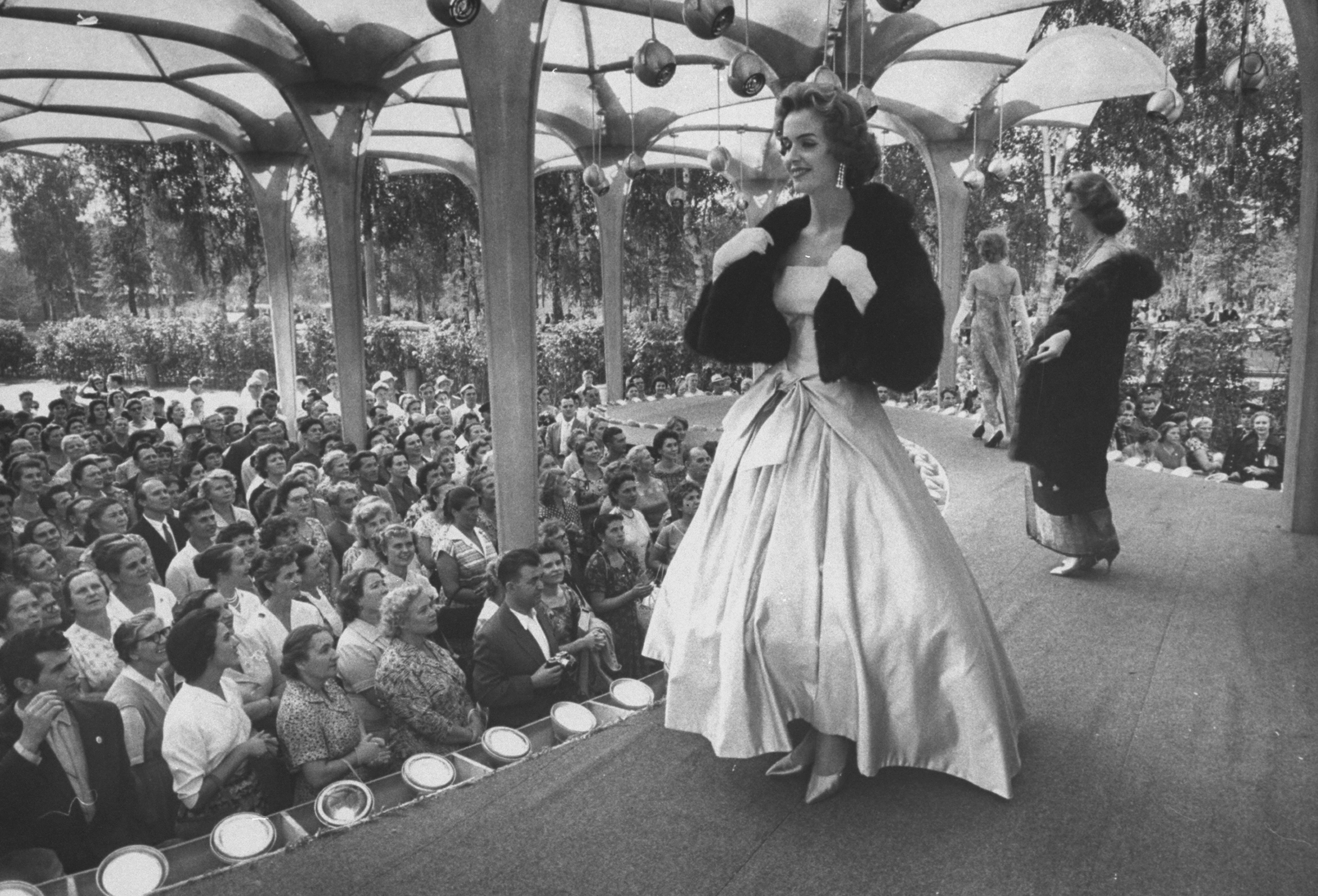 A woman models a gown at a special showing of American fashions in Moscow, 1959