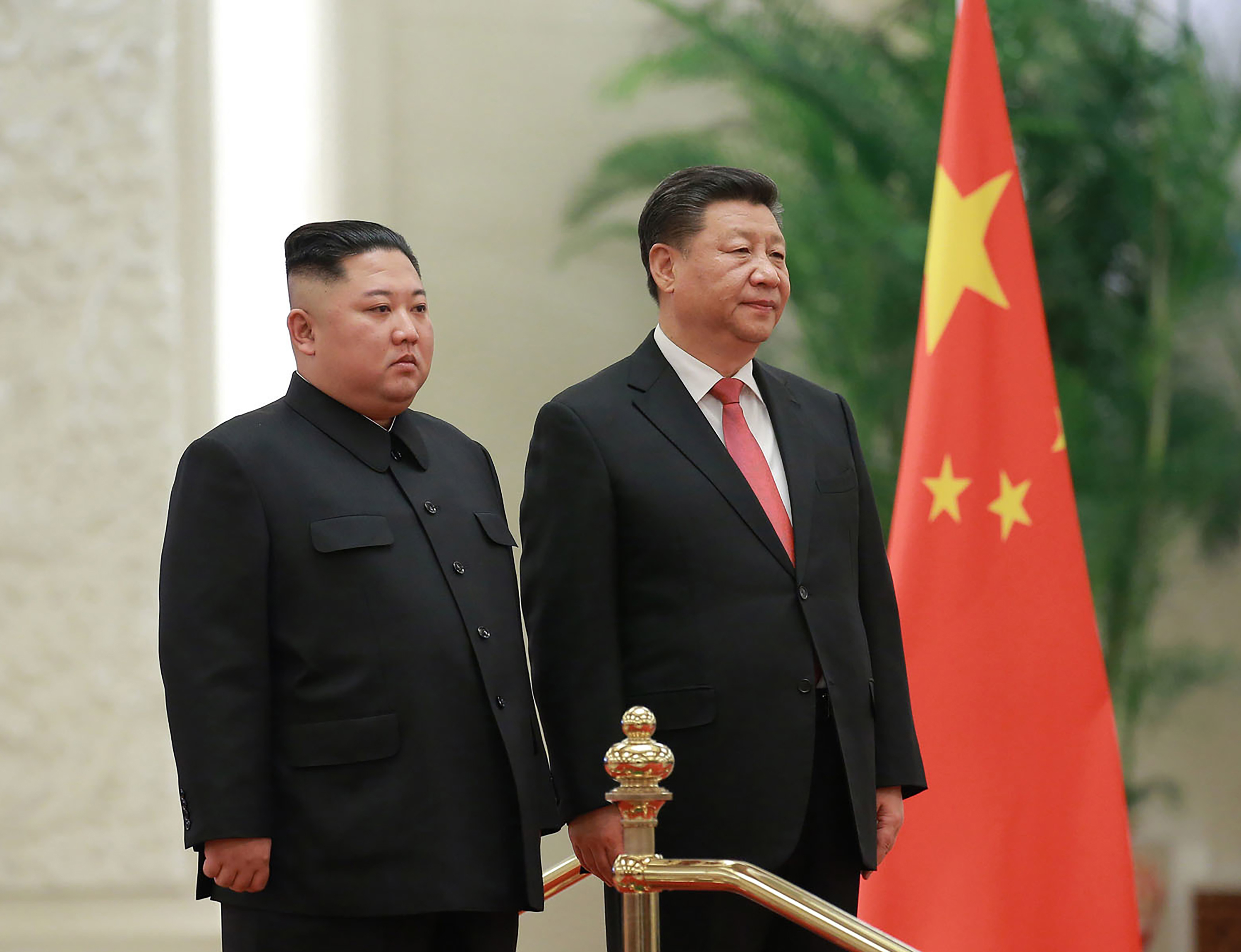 In this Jan. 8, 2019, file photo provided by the North Korean government, North Korean leader Kim Jong Un, left, and Chinese President Xi Jinping attend a welcome ceremony at the Great Hall of the People in Beijing.