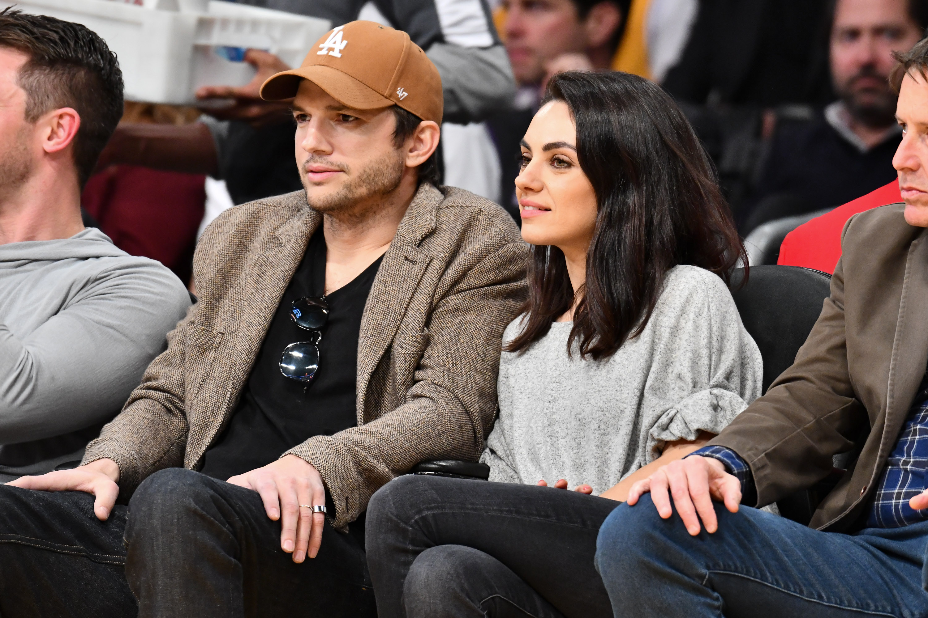 Ashton Kutcher and Mila Kunis attend a basketball game between the Los Angeles Lakers and the Philadelphia 76ers at Staples Center on January 29, 2019 in Los Angeles, California. (Photo by Allen Berezovsky/Getty Images)