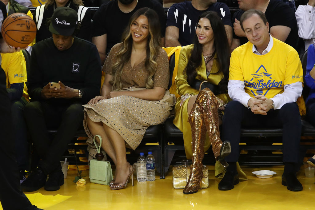 (L-R) Jay-Z, Beyonce, Nicole Curran and Joseph S. Lacob attend Game Three of the 2019 NBA Finals between the Golden State Warriors and the Toronto Raptors at ORACLE Arena on June 05, 2019 in Oakland, California.
