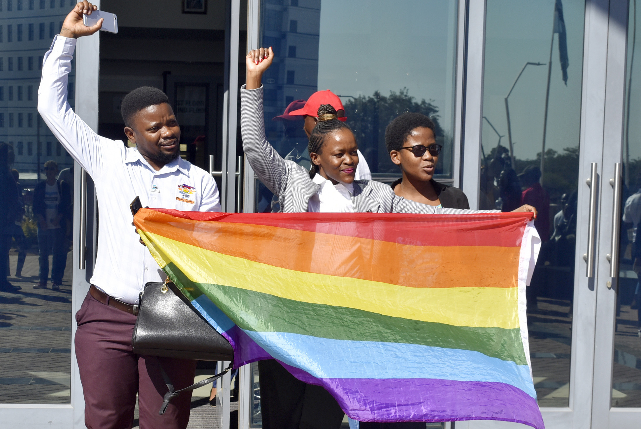 Activists celebrate outside the High Court in Gaborone, Botswana, on June 11, 2019. Botswana became the latest country to decriminalize gay sex when the High Court rejected as unconstitutional sections of the penal code that punish same-sex relations with up to seven years in prison.