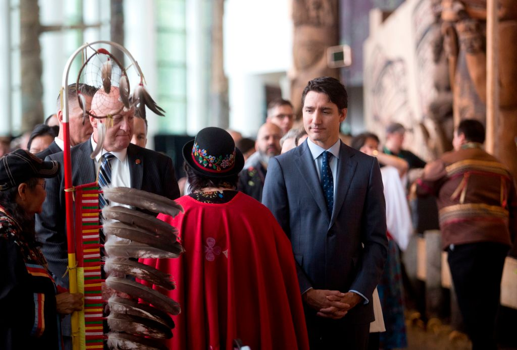 Prime Minister Justin Trudeau greets attendees at the closing ceremony marking the conclusion of the National Inquiry into Missing and Murdered Indigenous Women and Girls at the Museum of History in Gatineau, Quebec on June 3, 2019.
