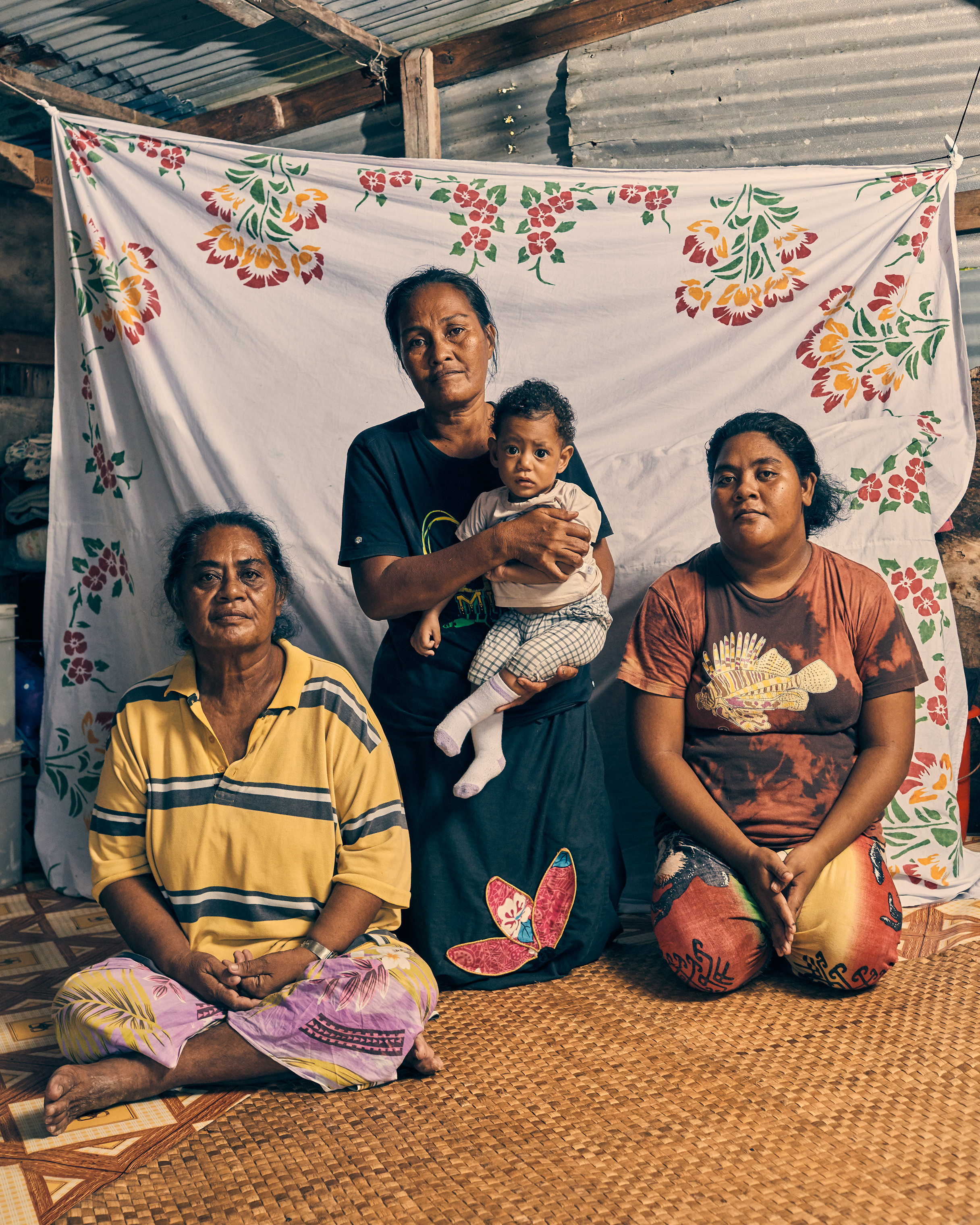 Members of the Salesa family, photographed in Funafuti, Tuvalu, on May 17. Their home floods four or five times a month, when the high tide comes in.