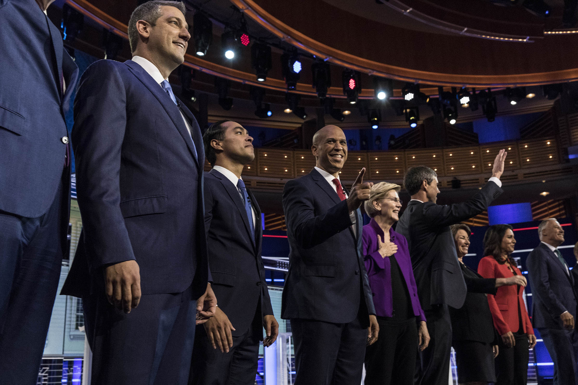 Democratic presidential candidates New York City Mayor Bill De Blasio (L-R), Rep. Tim Ryan (D-OH), former housing secretary Julian Castro, Sen. Cory Booker (D-NJ), Sen. Elizabeth Warren (D-MA), former Texas congressman Beto O'Rourke, Sen. Amy Klobuchar (D-MN), Rep. Tulsi Gabbard (D-HI), Washington Gov. Jay Inslee, take the stage during the first night of the Democratic presidential debate on June 26, 2019 in Miami, Florida.
