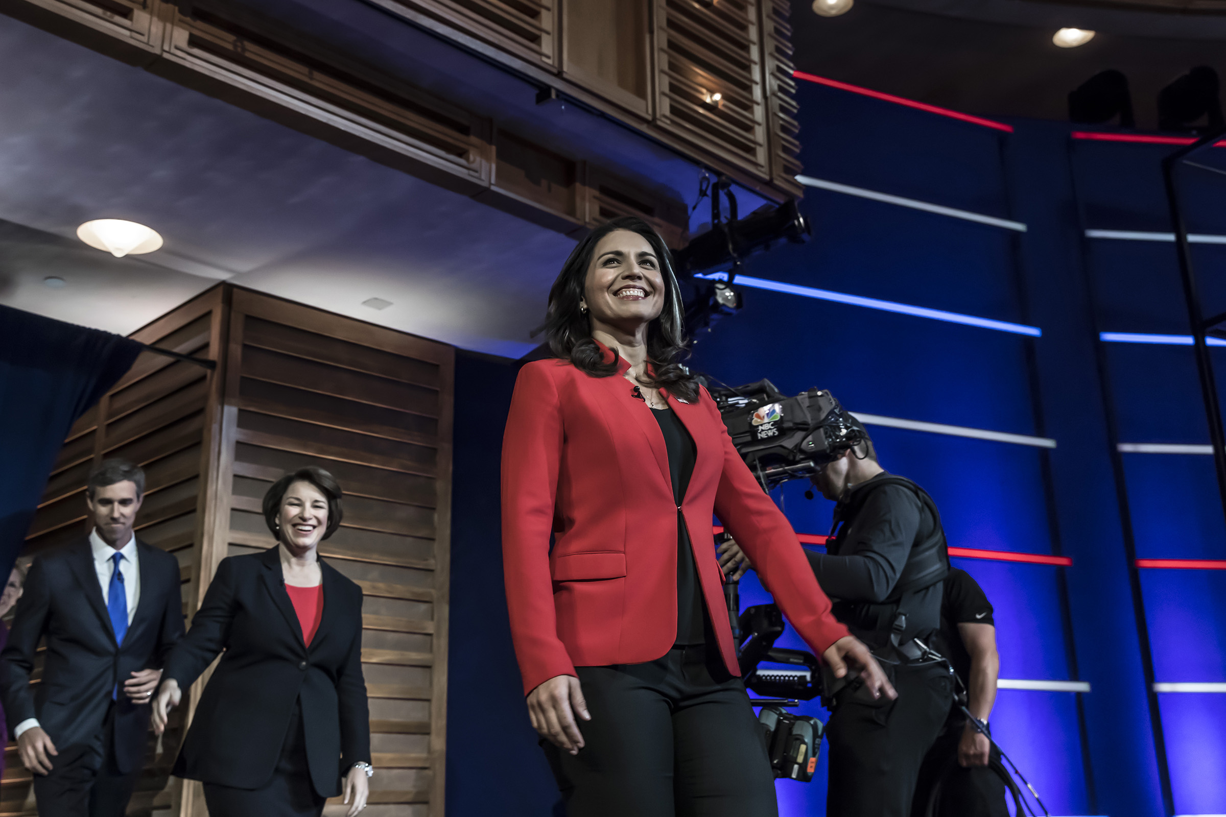 Presidential hopefuls (L-R) Former Texas Rep. Beto O'Rourke, Minnesota Sen. Amy Klobuchar and Hawaii Rep. Tulsi Gabbard arrive onstage for the first night of the Democratic presidential debate on June 26, 2019 in Miami, Florida.