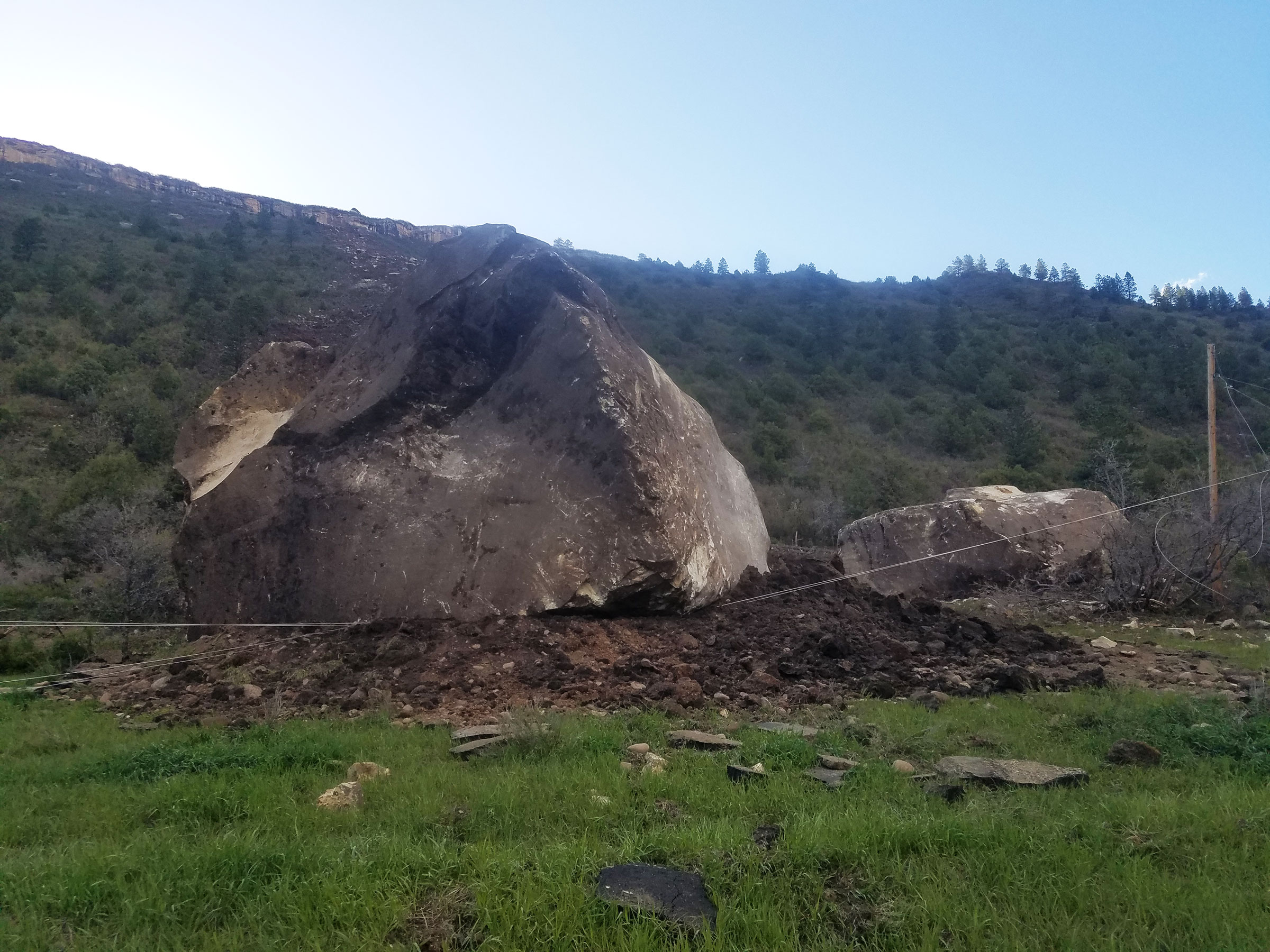 A massive boulder will stay put on Colorado Highway 145.