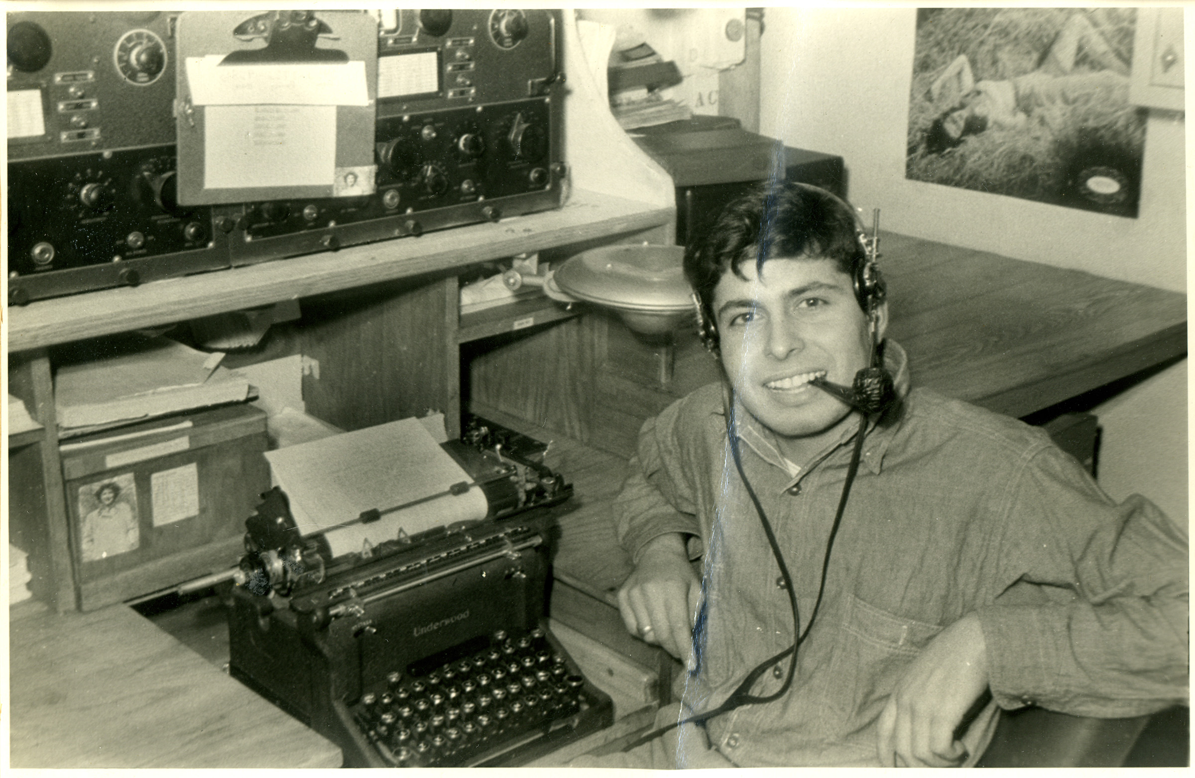 Radioman Peter Orlando sitting behind a typewriter on the recue-tug USS ATR-2. Orlando witnessed the landings at Omaha Beach from his tugboat.