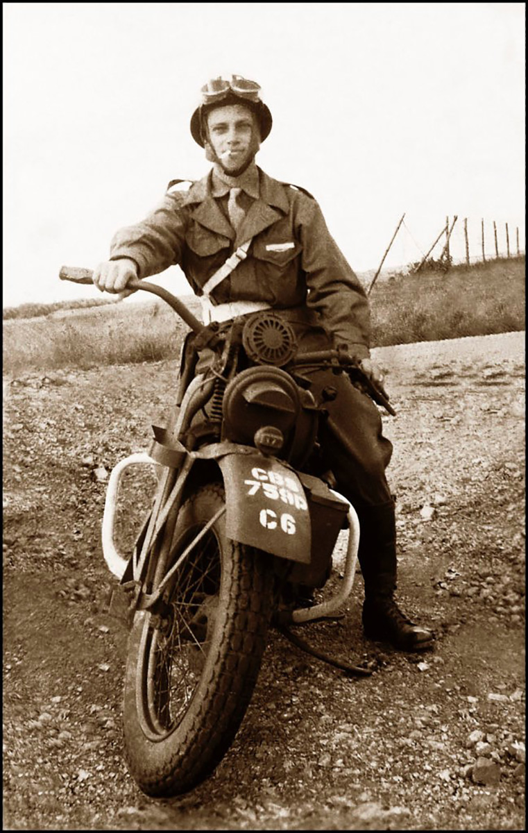 Pfc Norman Riggsby sitting on his Harley Davidson during the European campaign. After receiving wounds in Normandy, Riggsby transferred to the Military Police.