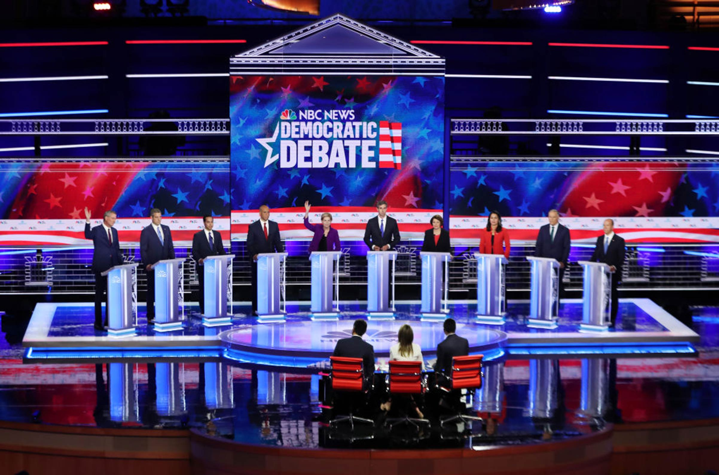 Democratic presidential candidates New York City Mayor Bill De Blasio (L-R), Rep. Tim Ryan (D-OH), former housing secretary Julian Castro, Sen. Cory Booker (D-NJ), Sen. Elizabeth Warren (D-MA), former Texas congressman Beto O'Rourke, Sen. Amy Klobuchar (D-MN), Rep. Tulsi Gabbard (D-HI), Washington Gov. Jay Inslee, and former Maryland congressman John Delaney take part in the first Democratic presidential debate on June 26, 2019 in Miami.