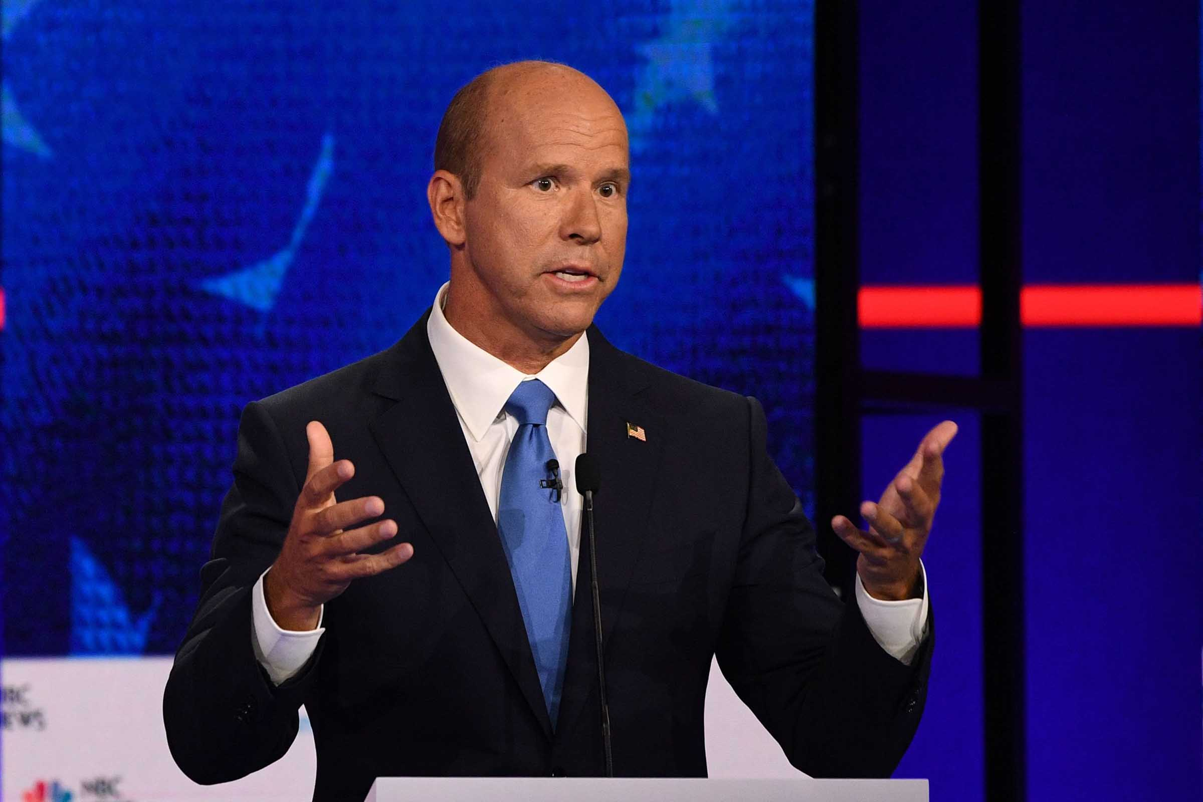 Democratic presidential hopeful former US Representative for Maryland's 6th congressional district John Delaney gestures as he speaks during the first Democratic primary debate of the 2020 presidential campaign season hosted by NBC News at the Adrienne Arsht Center for the Performing Arts in Miami, Florida, June 26, 2019.