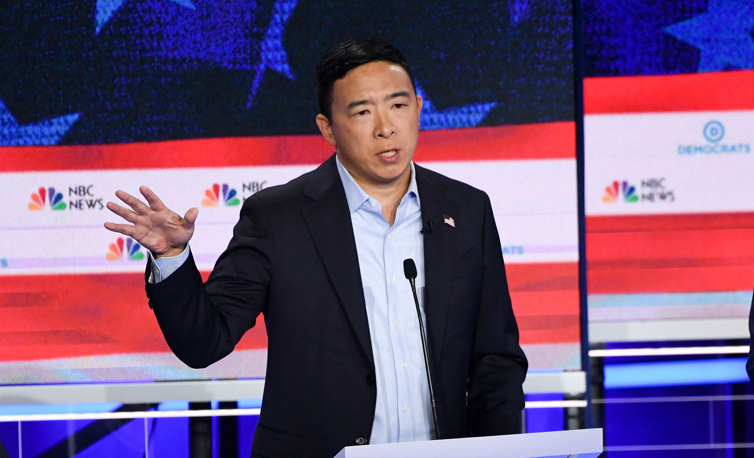 Democratic presidential hopeful US entrepreneur Andrew Yang speaks in the second Democratic primary debate of the 2020 presidential campaign season hosted by NBC News at the Adrienne Arsht Center for the Performing Arts in Miami, Florida, June 27, 2019.