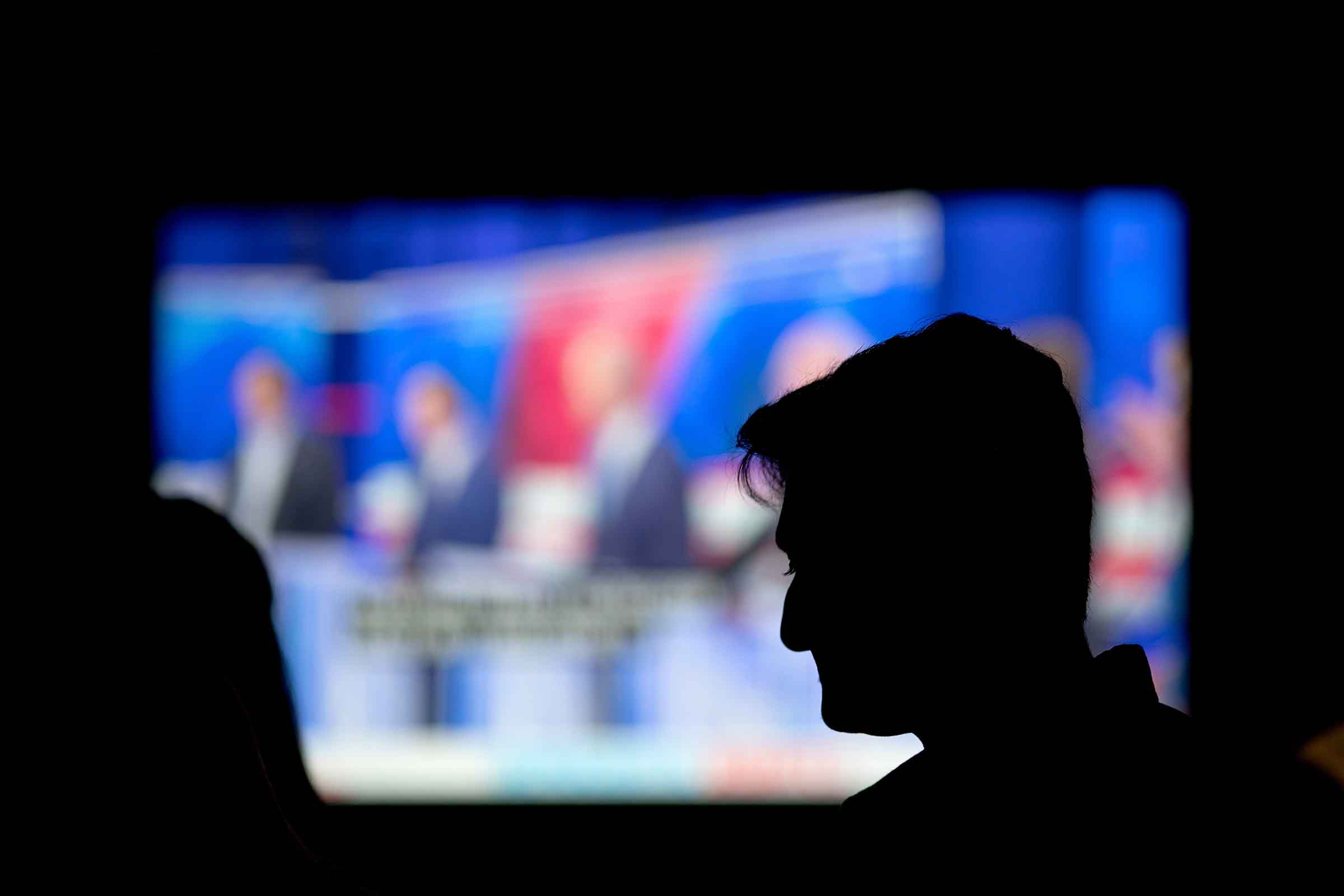 A person watches a broadcast of a Democratic presidential debate at a bar in Atlanta  on June 27, 2019.