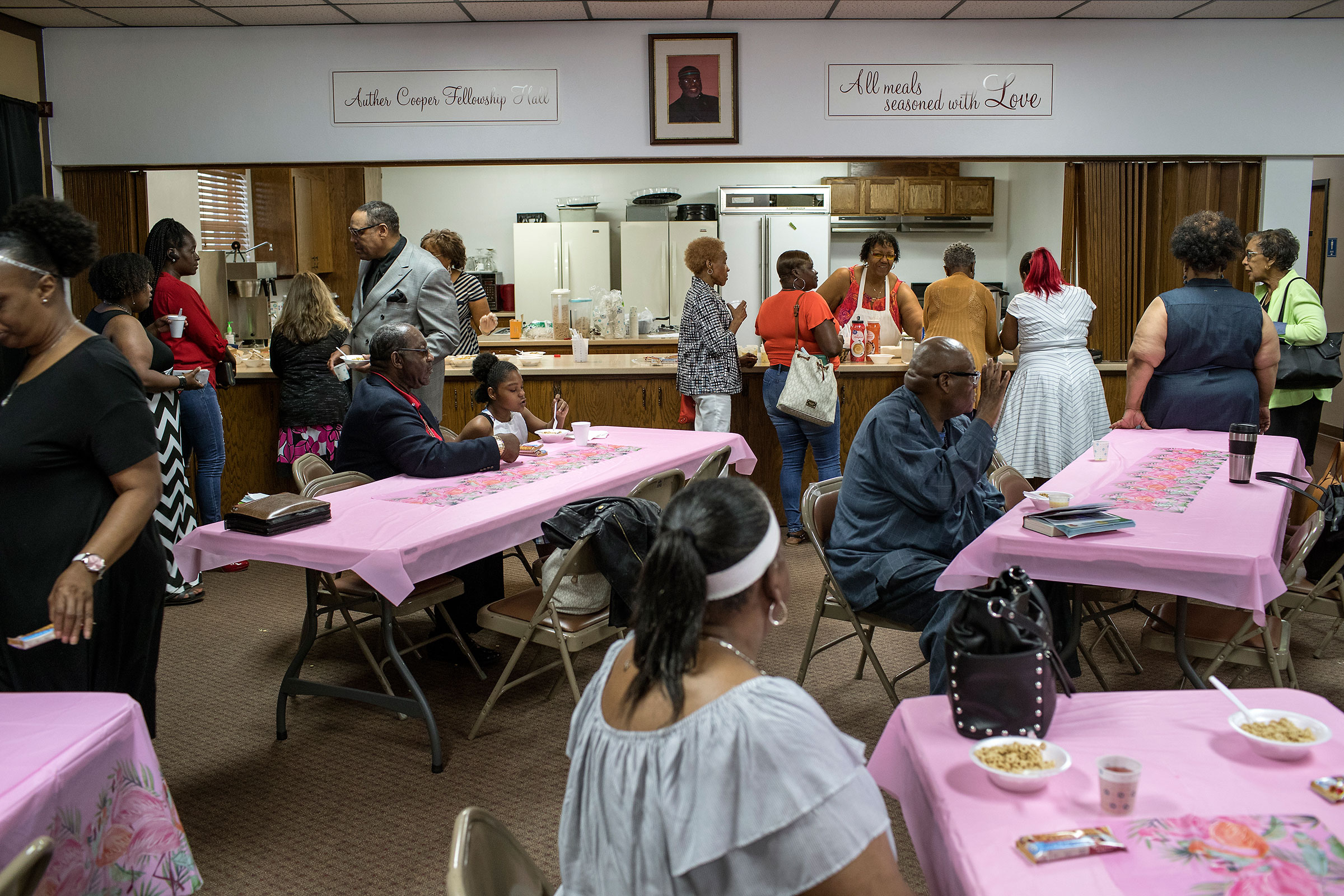 Community members enjoy coffee and breakfast before the Youth Empowerment Day service on June 9.