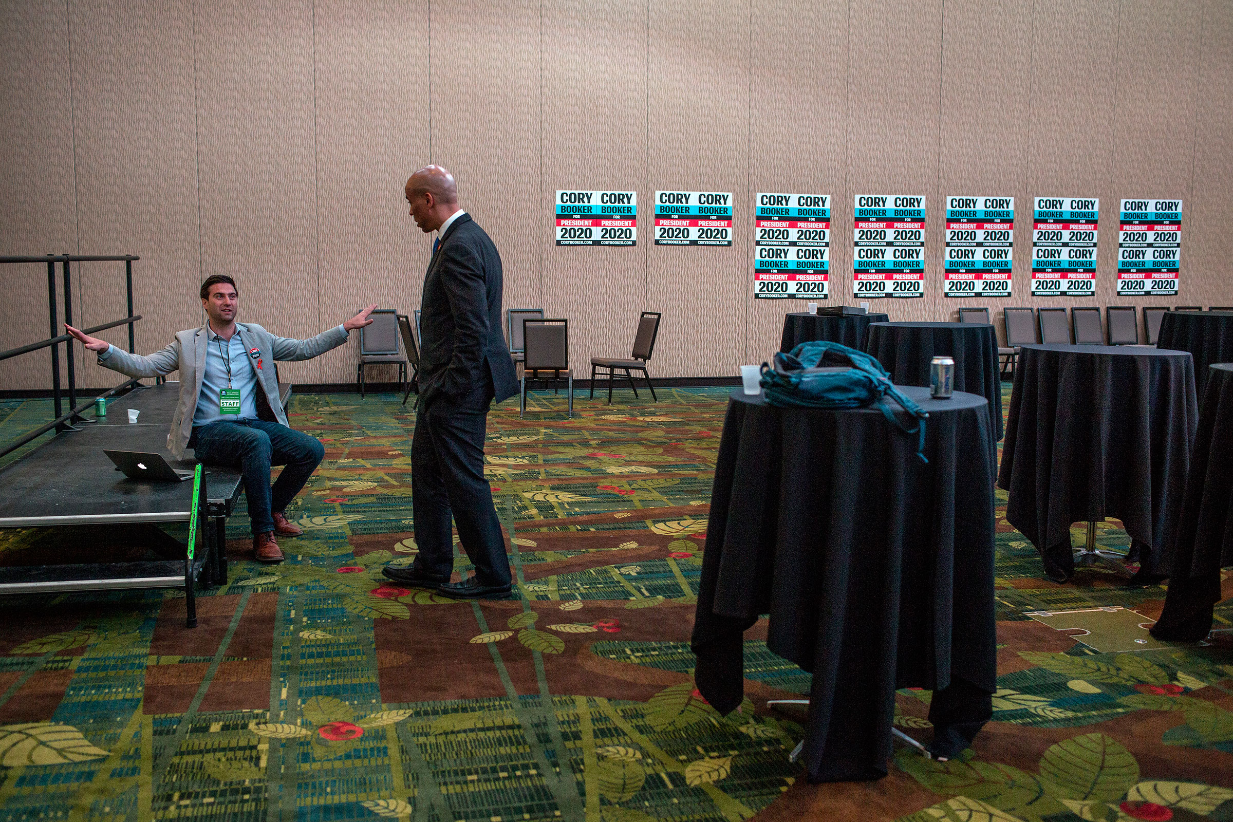 Booker speaks with Iowa State Director Mike Frosolone after a day of campaigning in the Grand Ballroom of the Cedar Rapids Double Tree Convention Complex following the Democratic Hall of Fame event on June, 9.