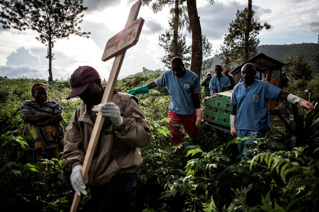 Health workers carry a coffin containing a victim of Ebola virus in Butembo, Democratic Republic of Congo, on May 16.