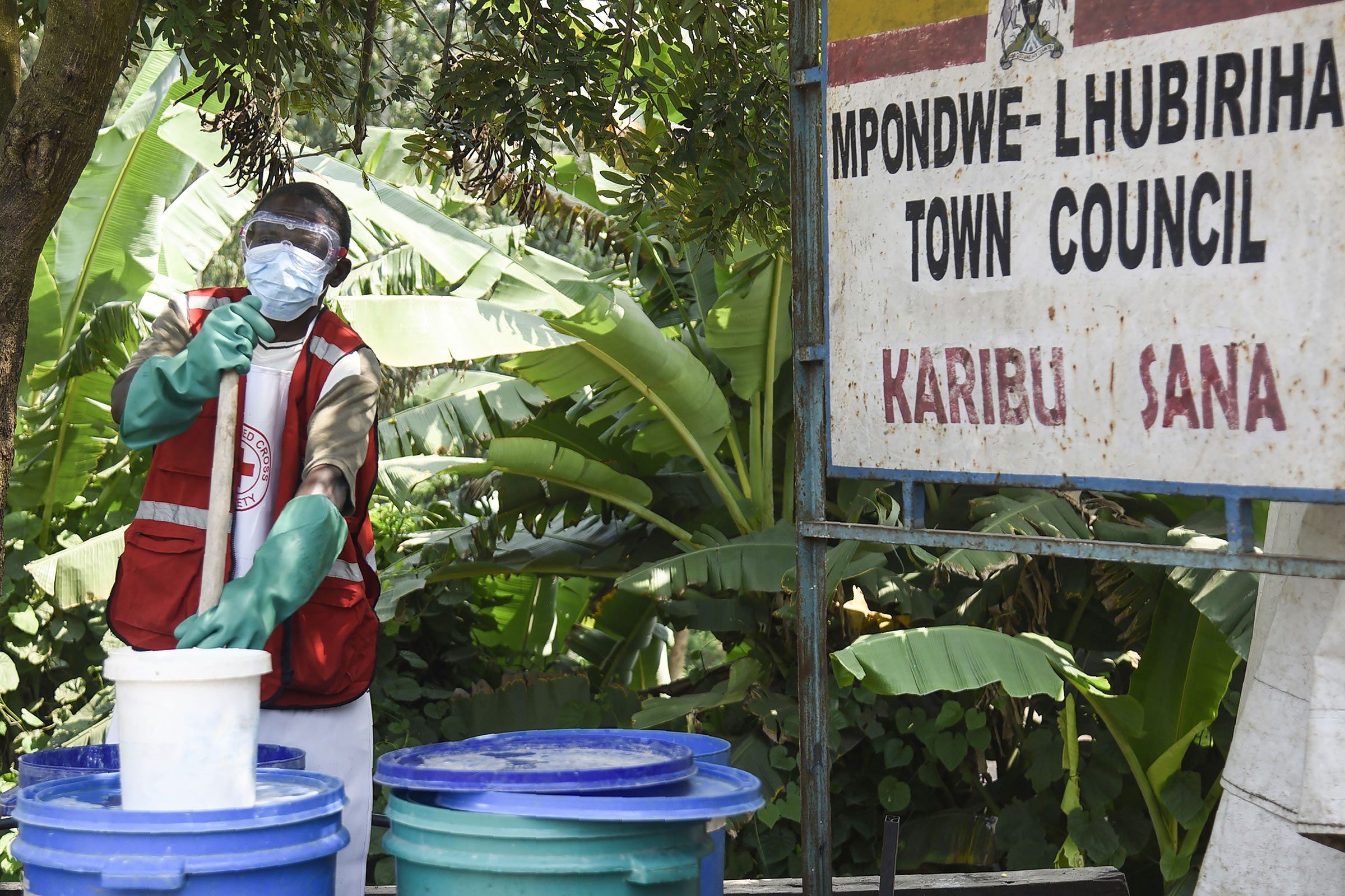 A health worker makes a chlorine solution for sanitisation at the Mpondwe Health Screening Facility in  Mpondwe, the Uganda's border town with the Democratic Republic of Congo, on June 13.