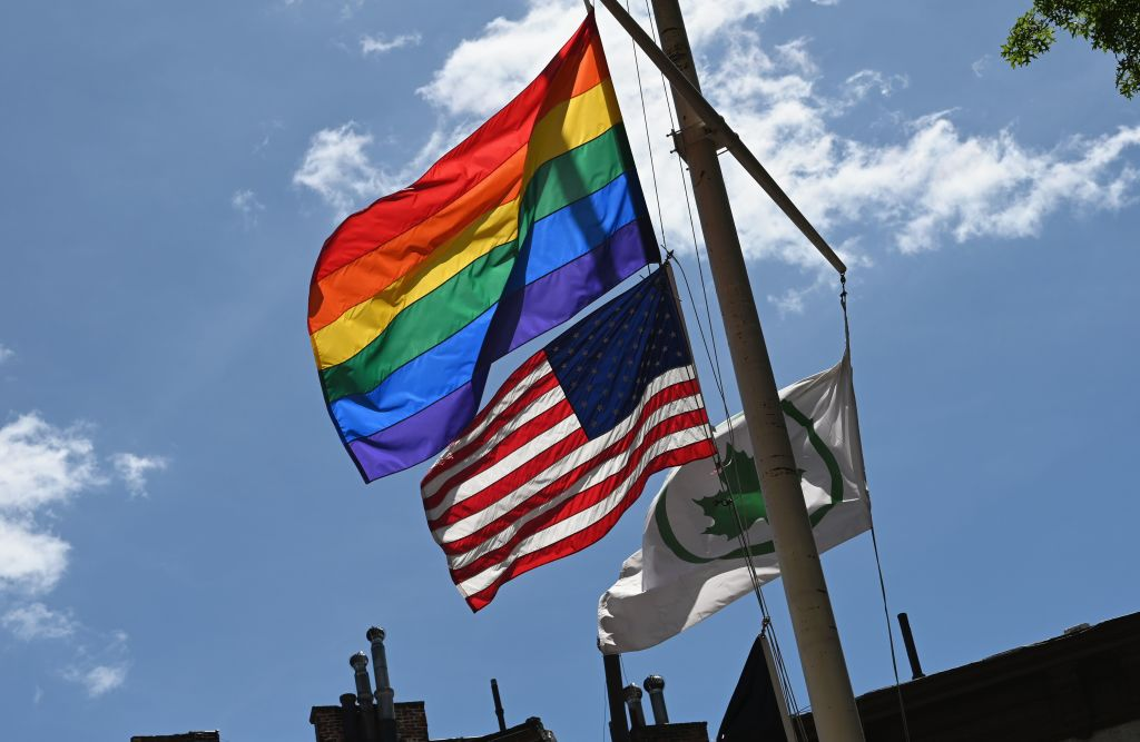A rainbow flag and an American Flag at the Stonewall National Monument on June 4, 2019 in New York City.
