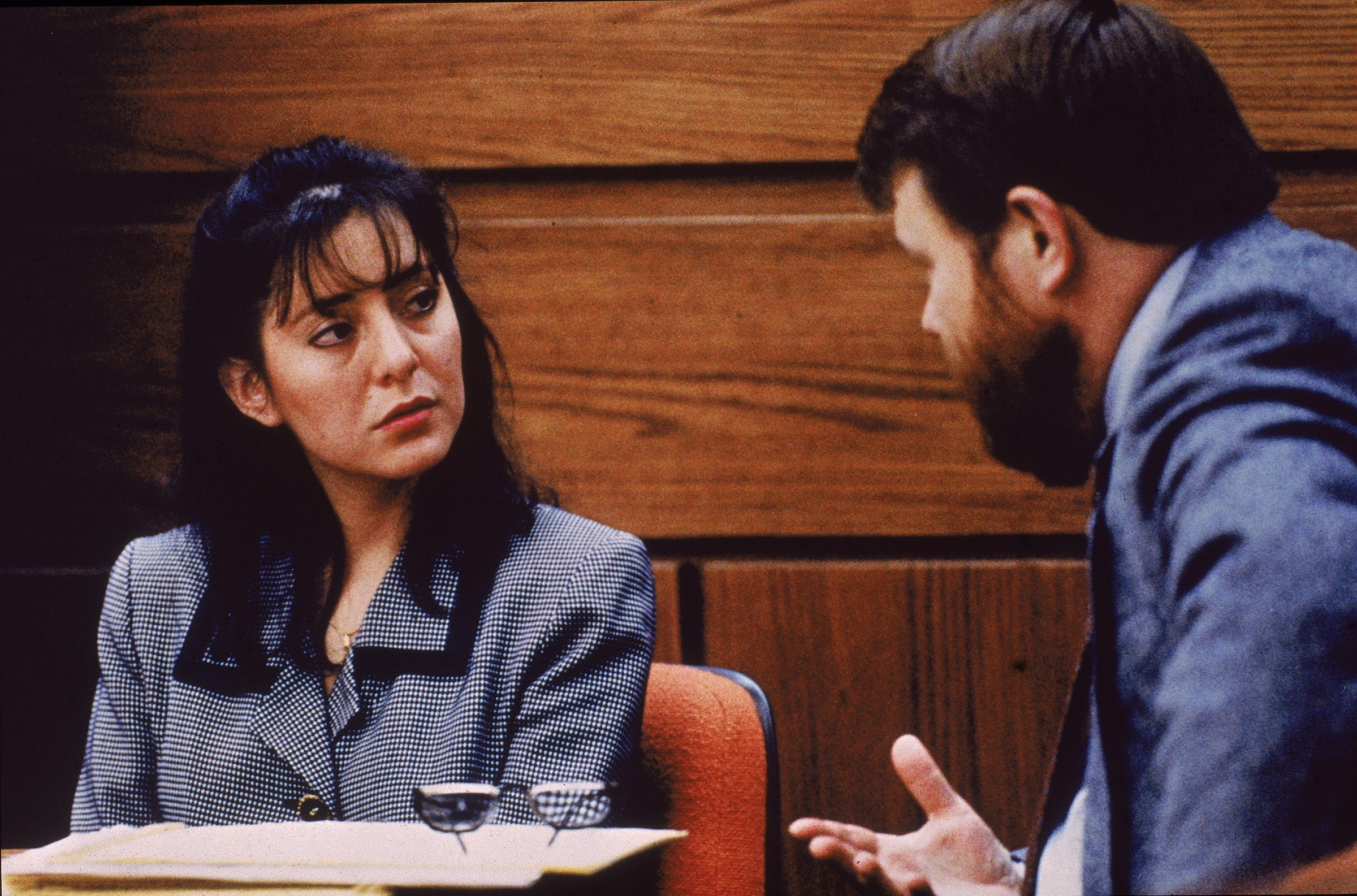 Lorena Bobbitt listens to a lawyer during her trial, Manassas, Virginia, January 1994. Bobbitt was on trial for cutting off her husband's penis; she was acquitted by reason of temporary insanity.
