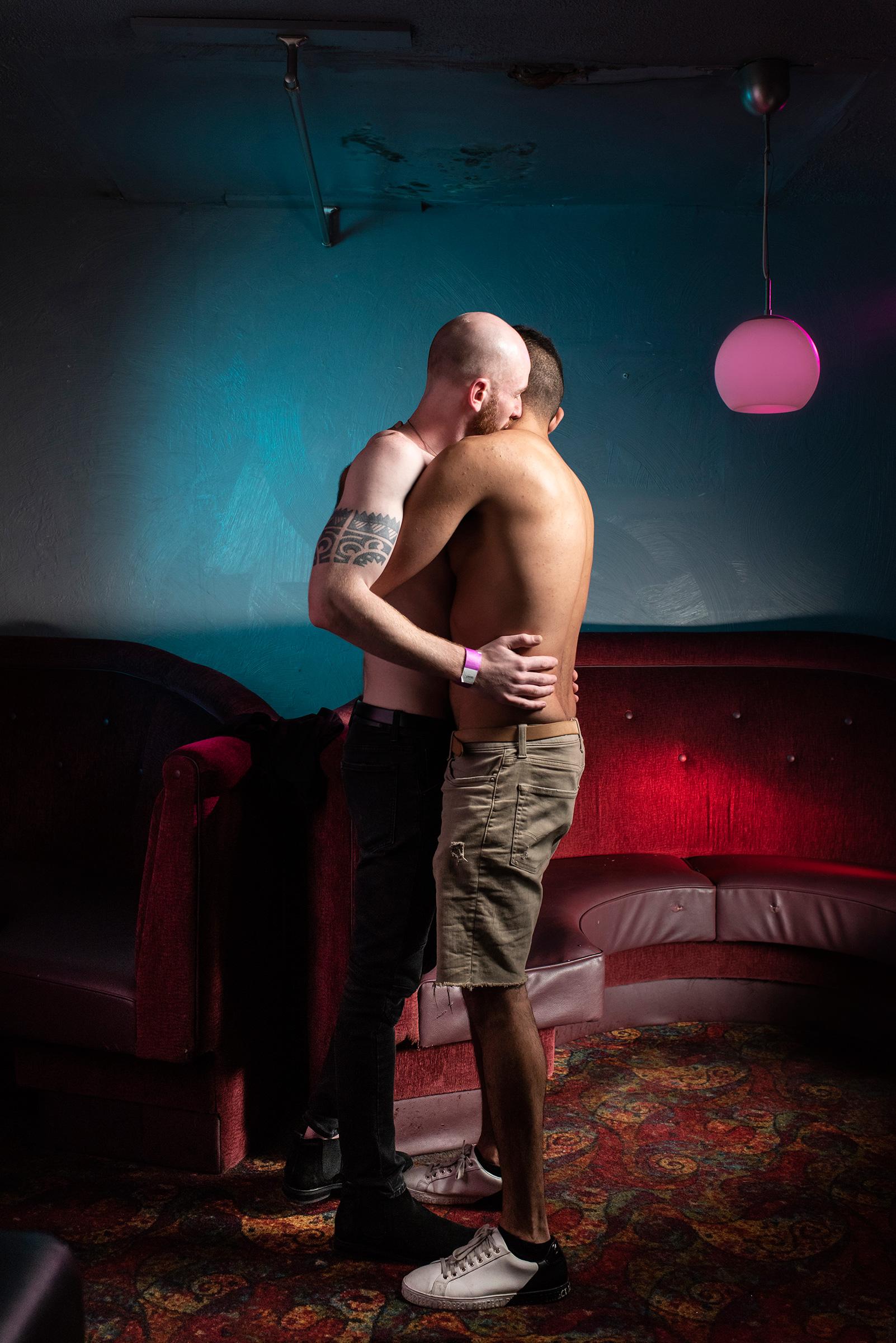 Zach Spaulding and Farzad Alikozai embrace at Stonewall.