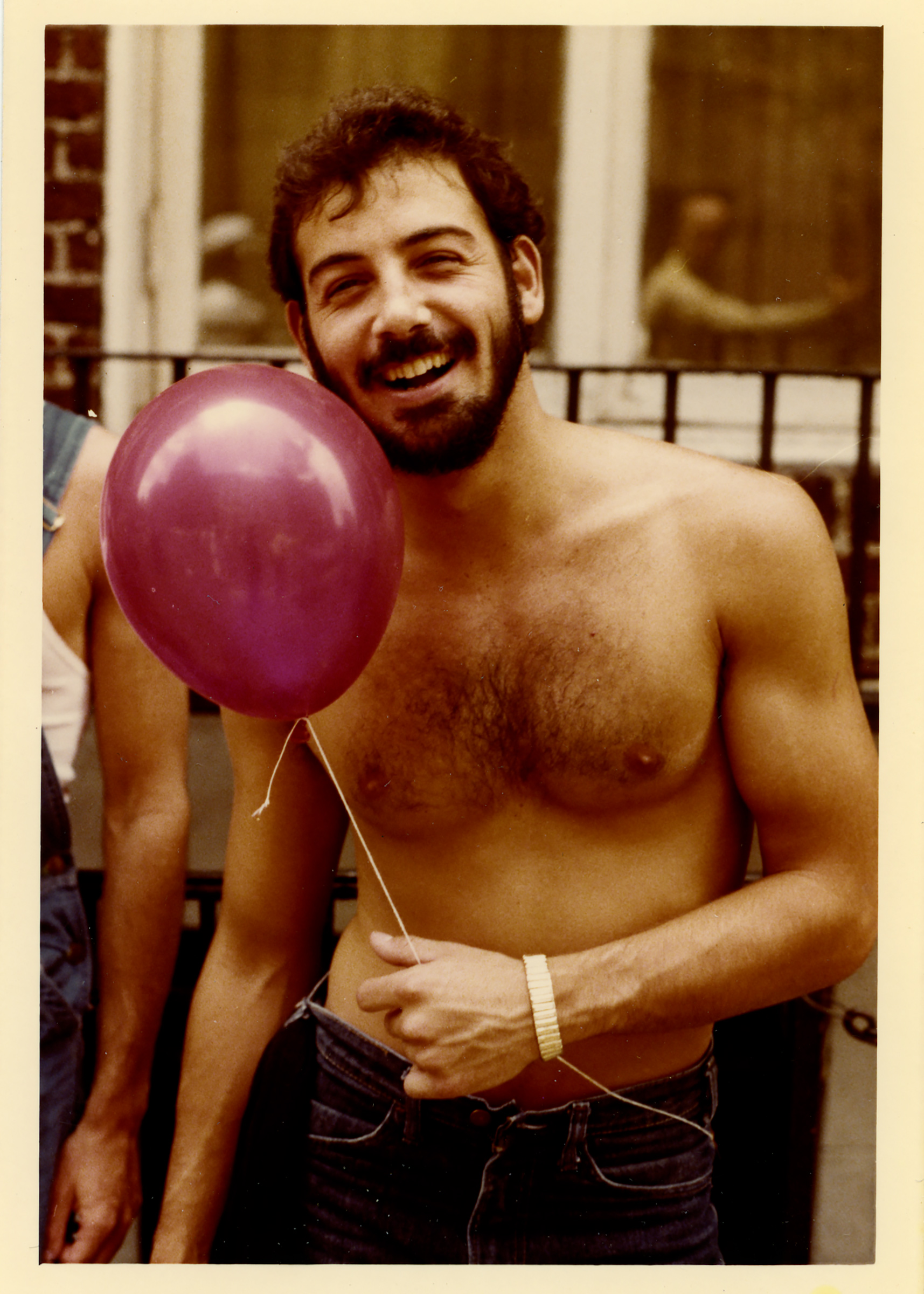 A man holds a balloon during the Pride Parade in New York City, 1977.