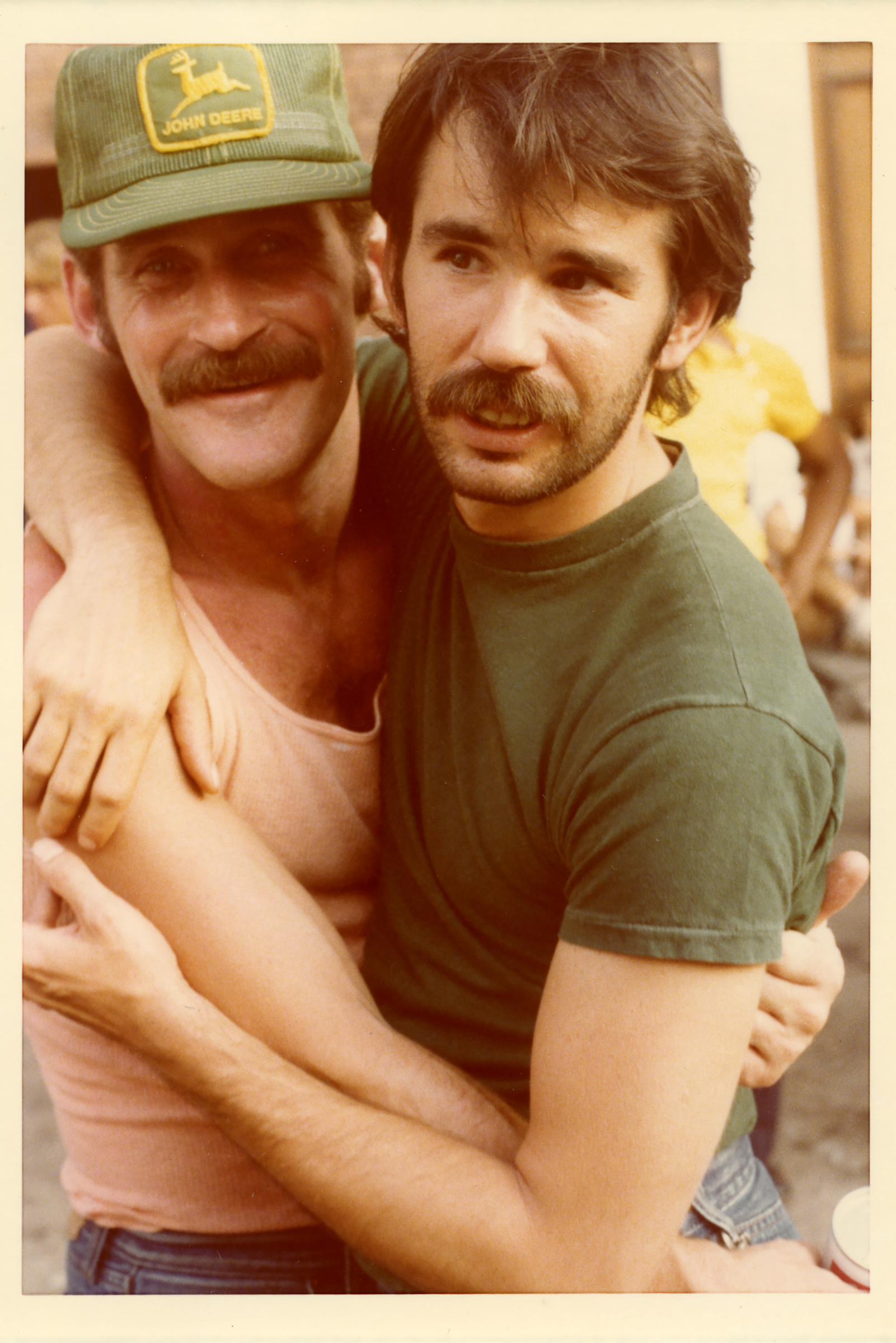 Two men embrace during Pride Parade 1977