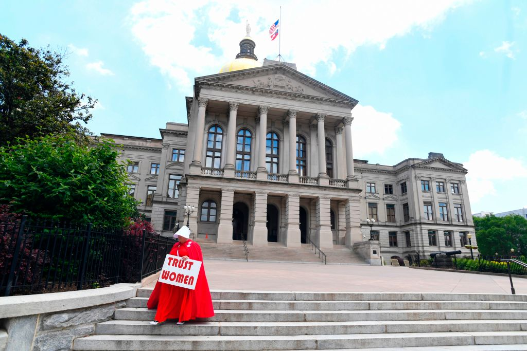 An activist leaves the Georgia Capitol after Democratic presidential candidate Sen. Kirsten Gillibrand addressed an event to speak out against the recently passed  heartbeat  bill in Atlanta, Georgia on May 16, 2019.