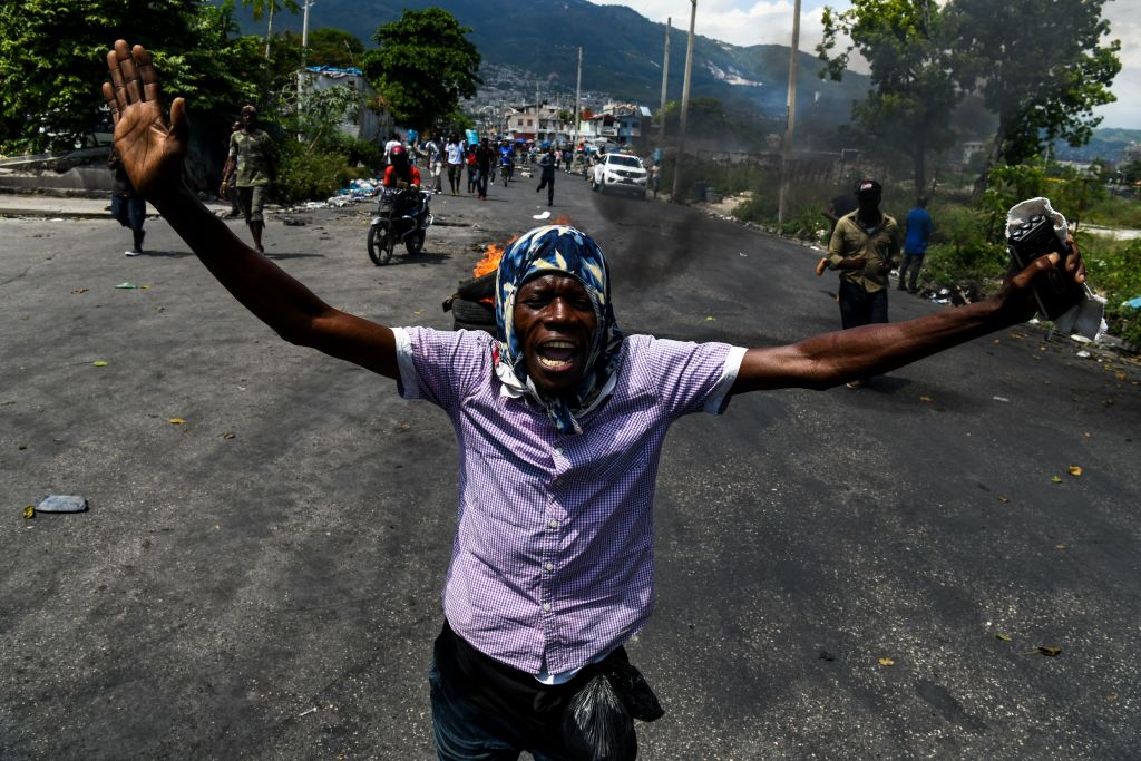 A demonstrator shouts slogans during a protest march against the ruling government in Port-au-Prince on June 13, 2019.