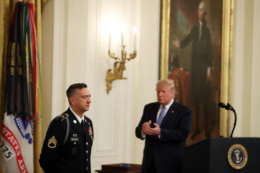 President Donald Trump awards the Medal of Honor the U.S. Army Staff Sgt. David Bellavia Ret., during a ceremony in the East Room at the White House, on June 25, 2019 in Washington, DC. Staff Sgt. Bellavia is receiving the nation's highest military honor for his heroism for rescuing his squad and clearing out a house full of Iraqi insurgents during the Second Battle of Fallujah in Iraq in 2004.
