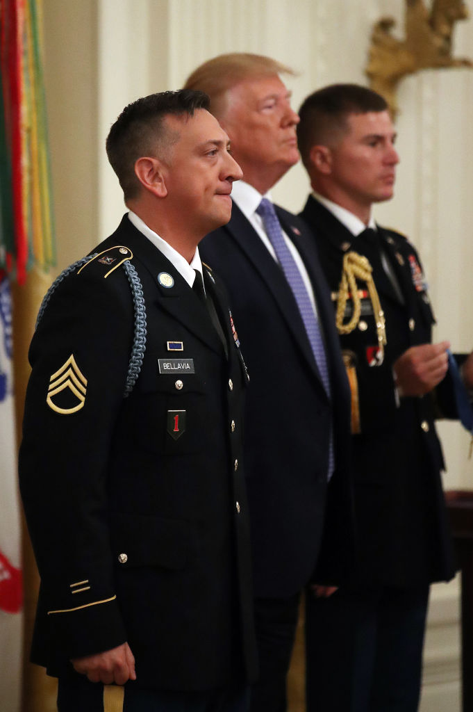 WASHINGTON, DC - JUNE 25: U.S. President Donald Trump awards the Medal of Honor the U.S. Army Staff Sgt. David Bellavia Ret., during a ceremony in the East Room at the White House, on June 25, 2019 in Washington, DC. Staff Sgt. Bellavia is receiving the nation's highest military honor for his heroism for rescuing his squad and clearing out a house full of Iraqi insurgents during the Second Battle of Fallujah in Iraq in 2004. (Photo by Mark Wilson/Getty Images)