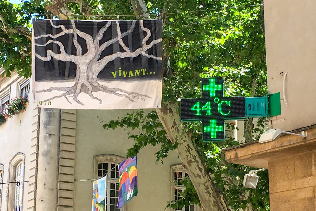 A picture taken on June 28, 2019 shows a pharmacy screen sign indicating the temperature of 44 degrees Celsius in Carpentras, south-eastern France.
