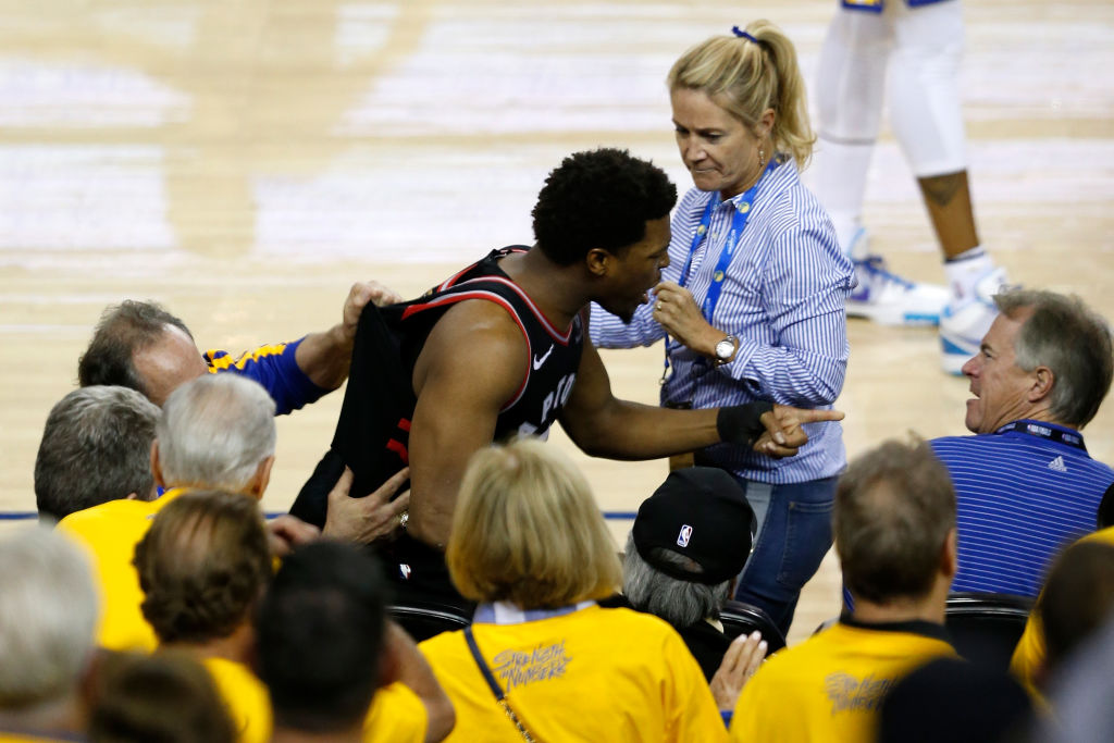 Kyle Lowry of the Toronto Raptors argues with Warriors minority investor Mark Stevens after Lowry chased down a loose ball during Game 3 of the 2019 NBA Finals in Oakland, Calif on June 5, 2019.