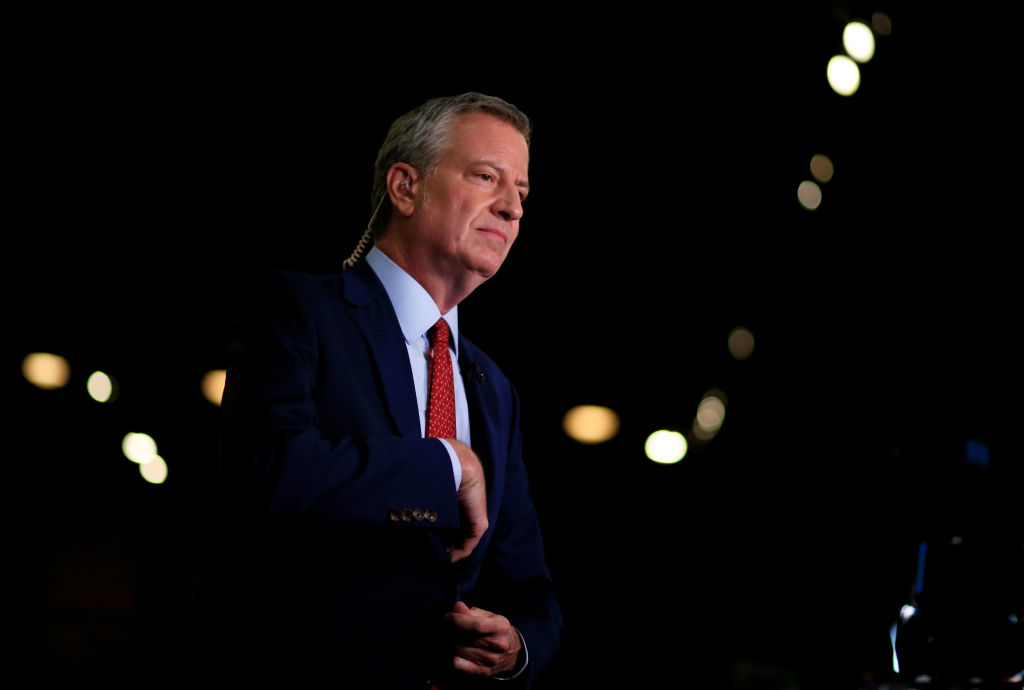 Democratic presidential candidate New York City Mayor Bill De Blasio prepares for a television interview in the spin room before the second night of the first Democratic presidential debate June 27, 2019 in Miami, Florida.