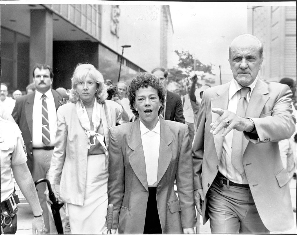 Prosecutors Linda Fairstein (left) and Elizabeth Lederer (right) are escorted from court after summations at lunchtime under heavy security against jeering demonstrators on August 06, 1990.