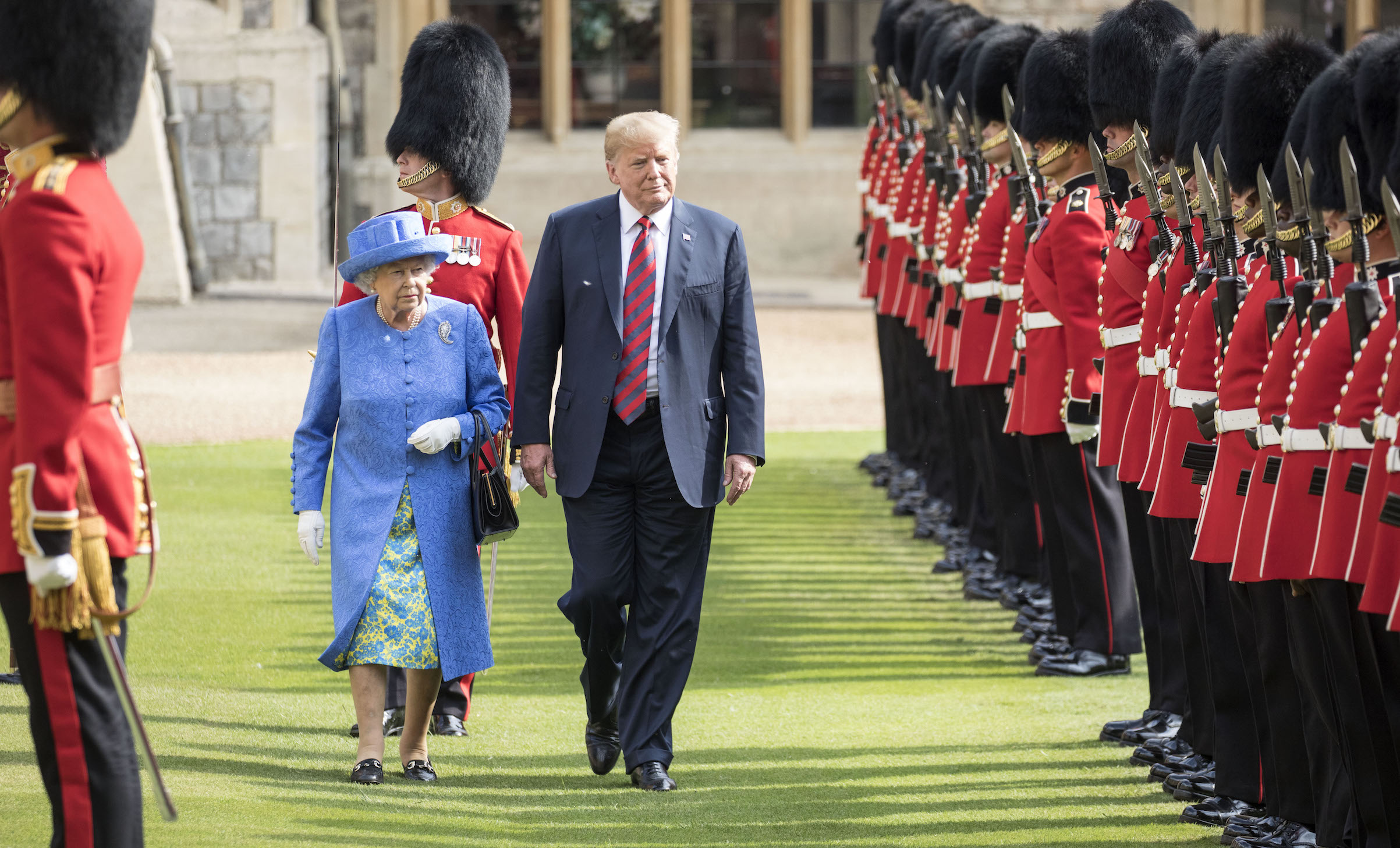 The Queen walks with President Trump as they inspect the Coldstream guards at Windsor castle on July 13, 2018.
