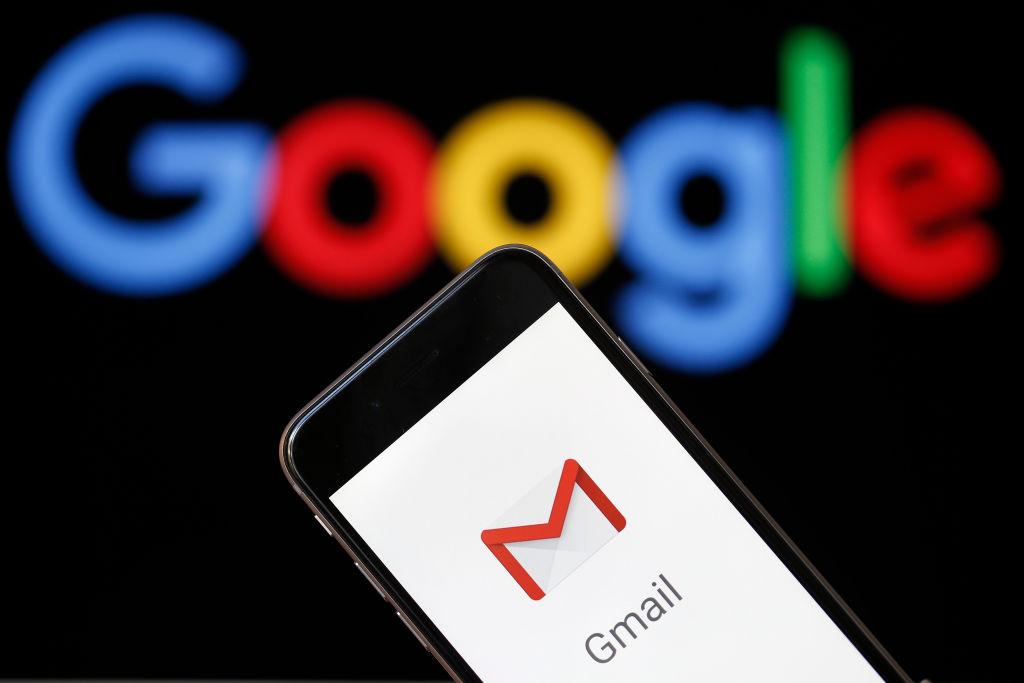 In this photo illustration, the logo of the Gmail app homepage is seen on the screen of an iPhone in front of a computer screen showing a Google logo on July 04, 2018 in Paris, France.  According to the Wall Street Journal dozens of Google partner companies have access to emails from 1.5 billion Gmail users. Gmail is a free email service offered by Google.