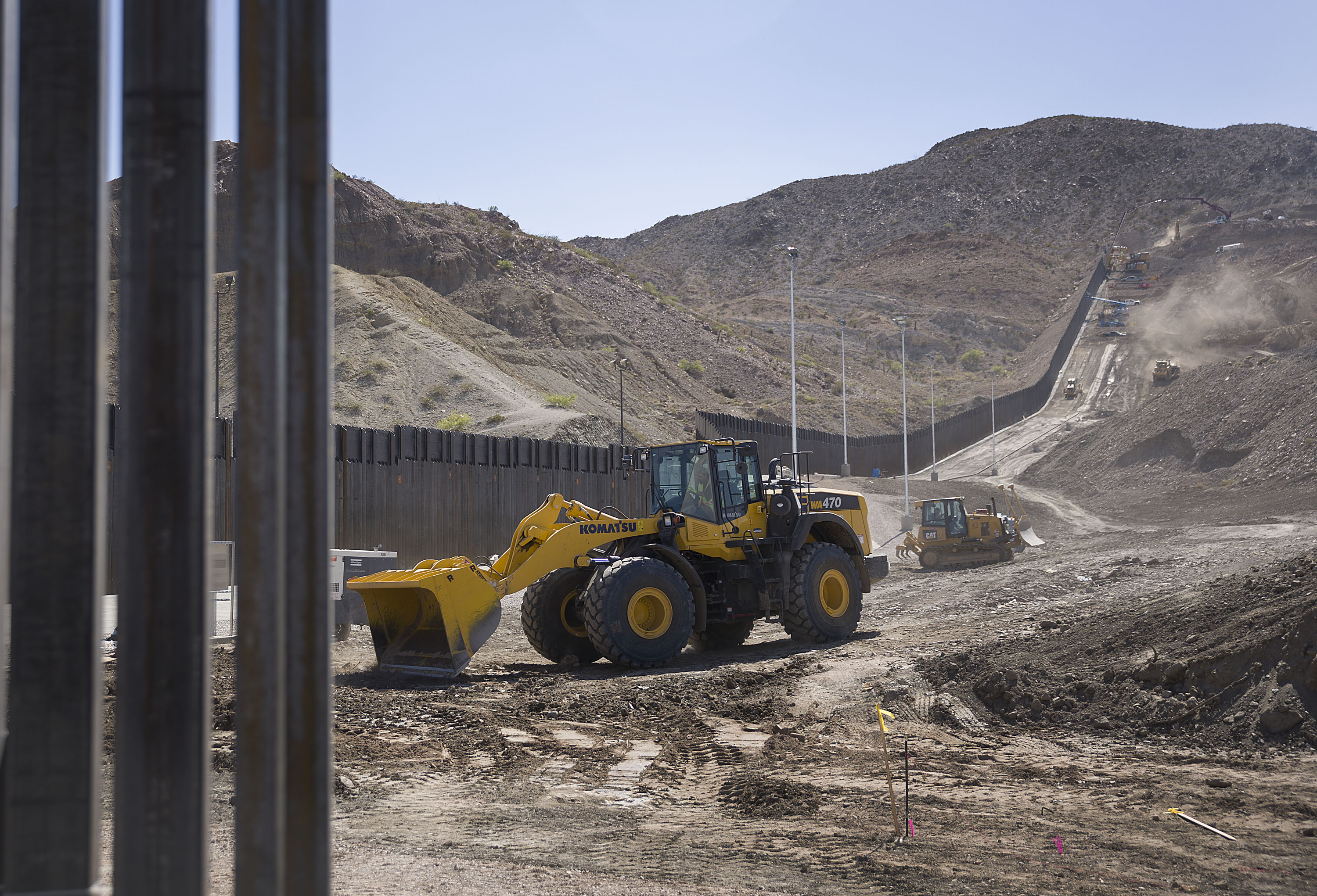 Construction crews work on a border wall being put in place by We Build The Wall Inc. on June 1, 2019 in Sunland Park, New Mexico.