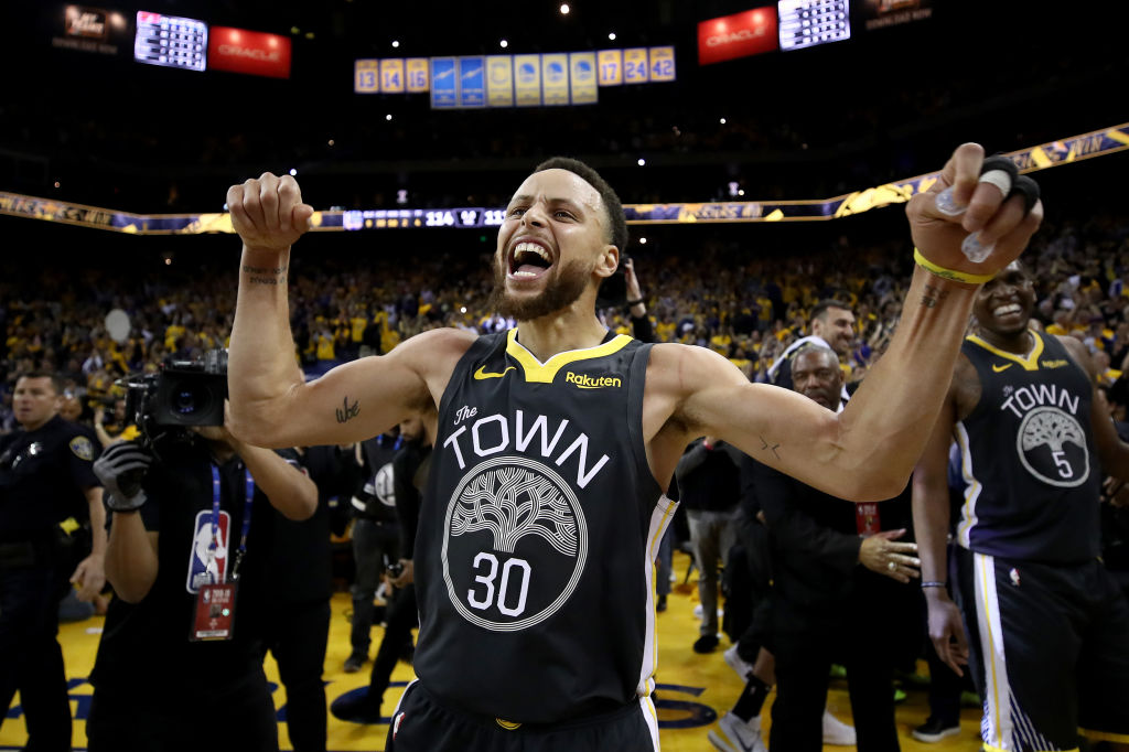 Stephen Curry #30 of the Golden State Warriors celebrates after defeating the Portland Trail Blazers 114-111 in game two of the NBA Western Conference Finals at ORACLE Arena on May 16, 2019 in Oakland, California.