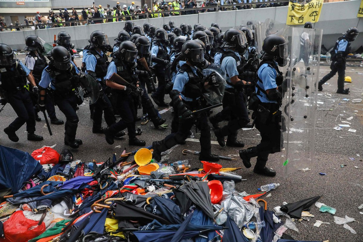 Police advance toward protesters outside the government headquarters on June 12.