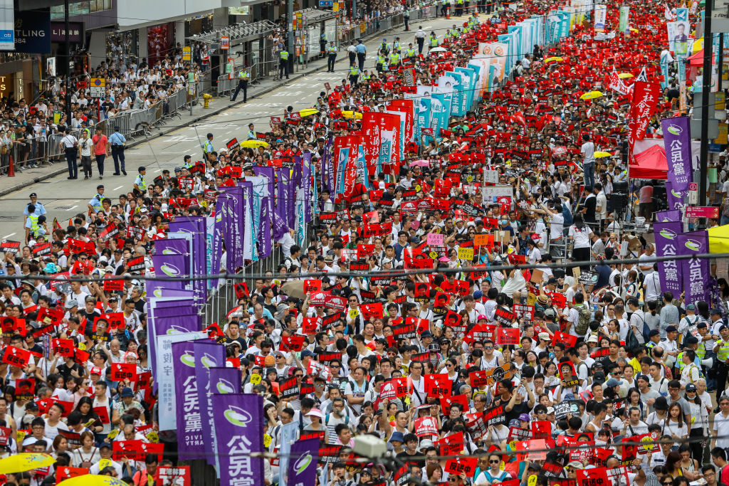 Protesters march during a rally against a controversial extradition law proposal in Hong Kong on June 9, 2019.